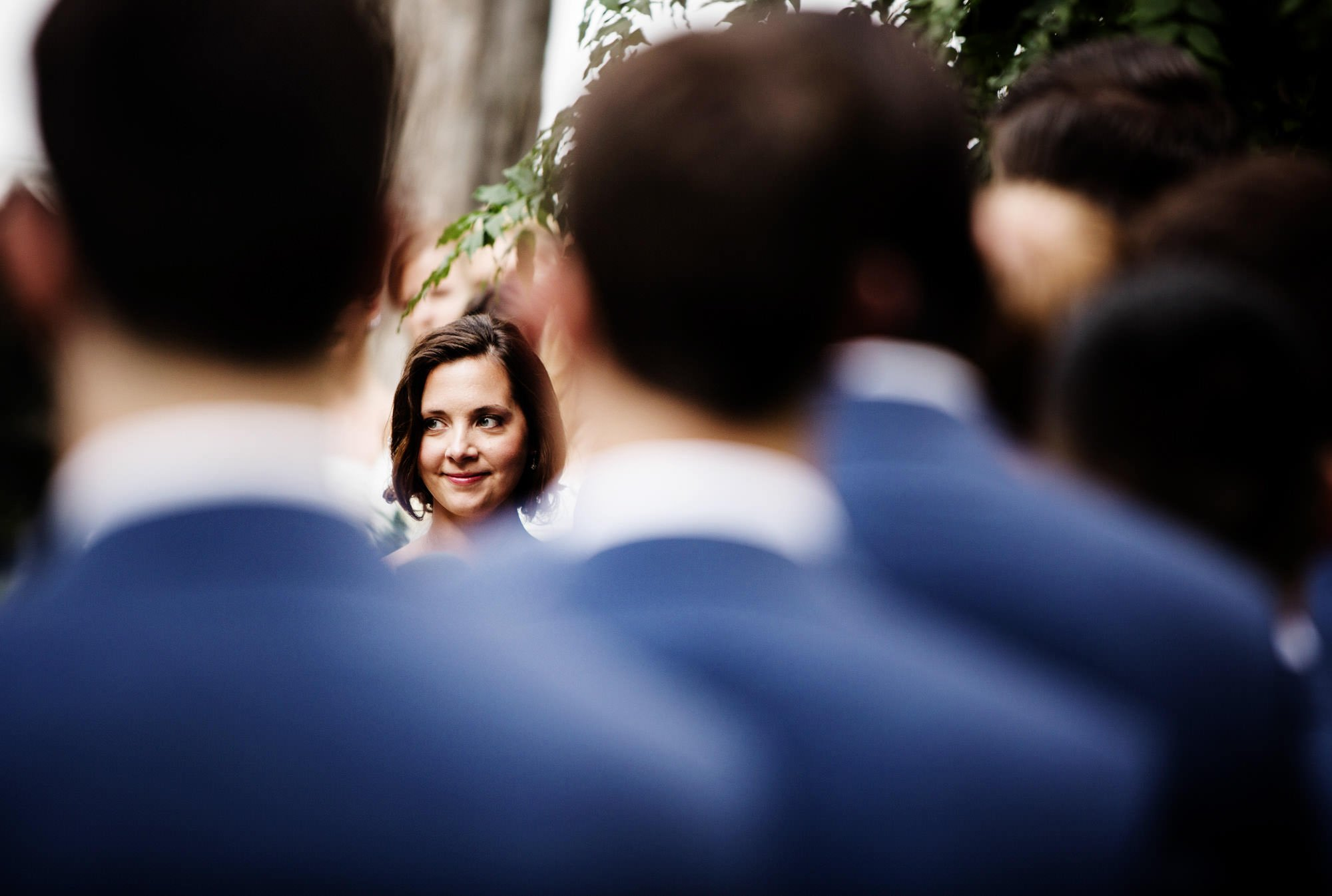 The bride looks at her groom during the wedding ceremony.
