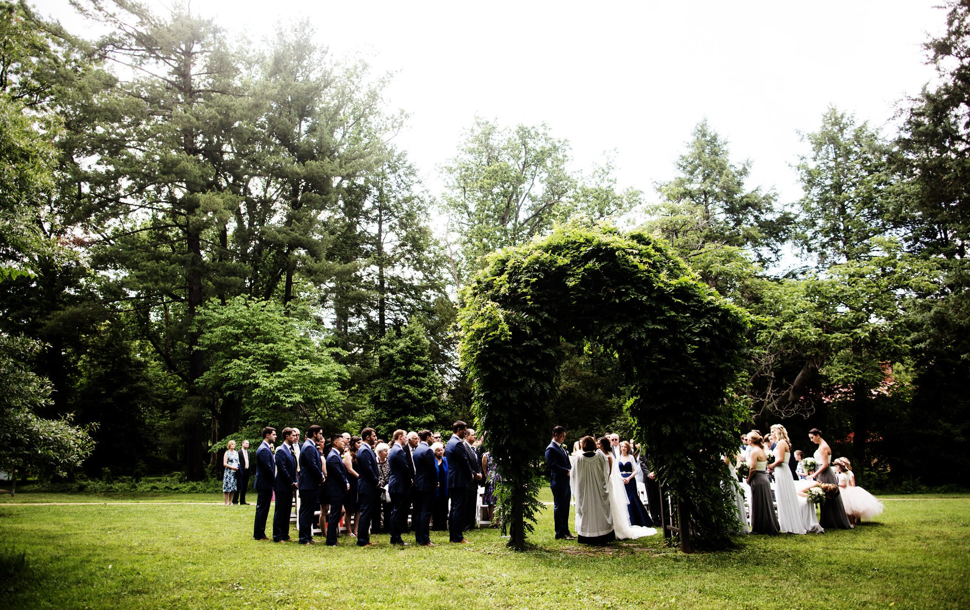The wedding ceremony on the grounds of Hendry House in Arlington, VA.