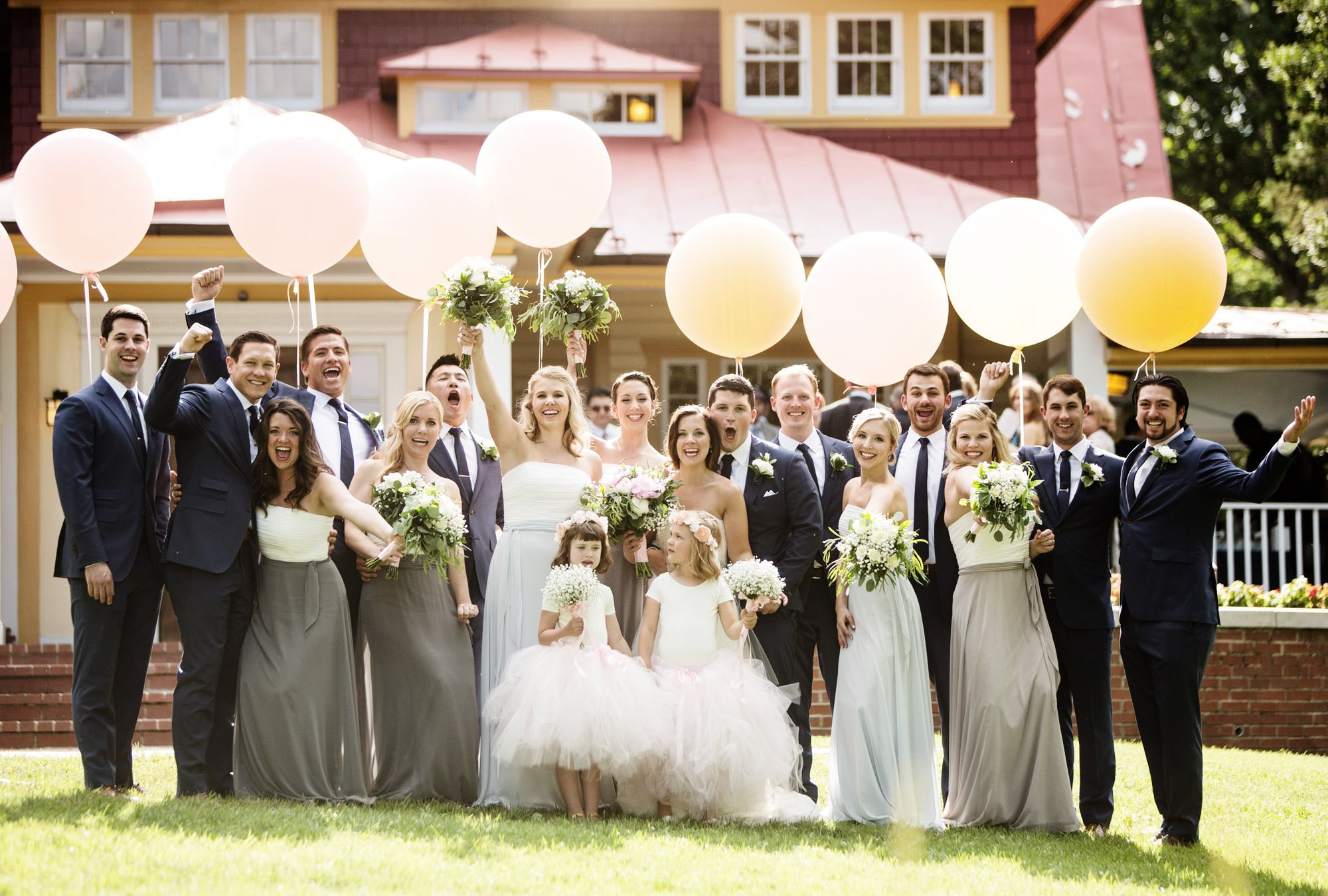 Hendry House Wedding in Arlington, VA  I  The wedding party cheers on the front lawn.