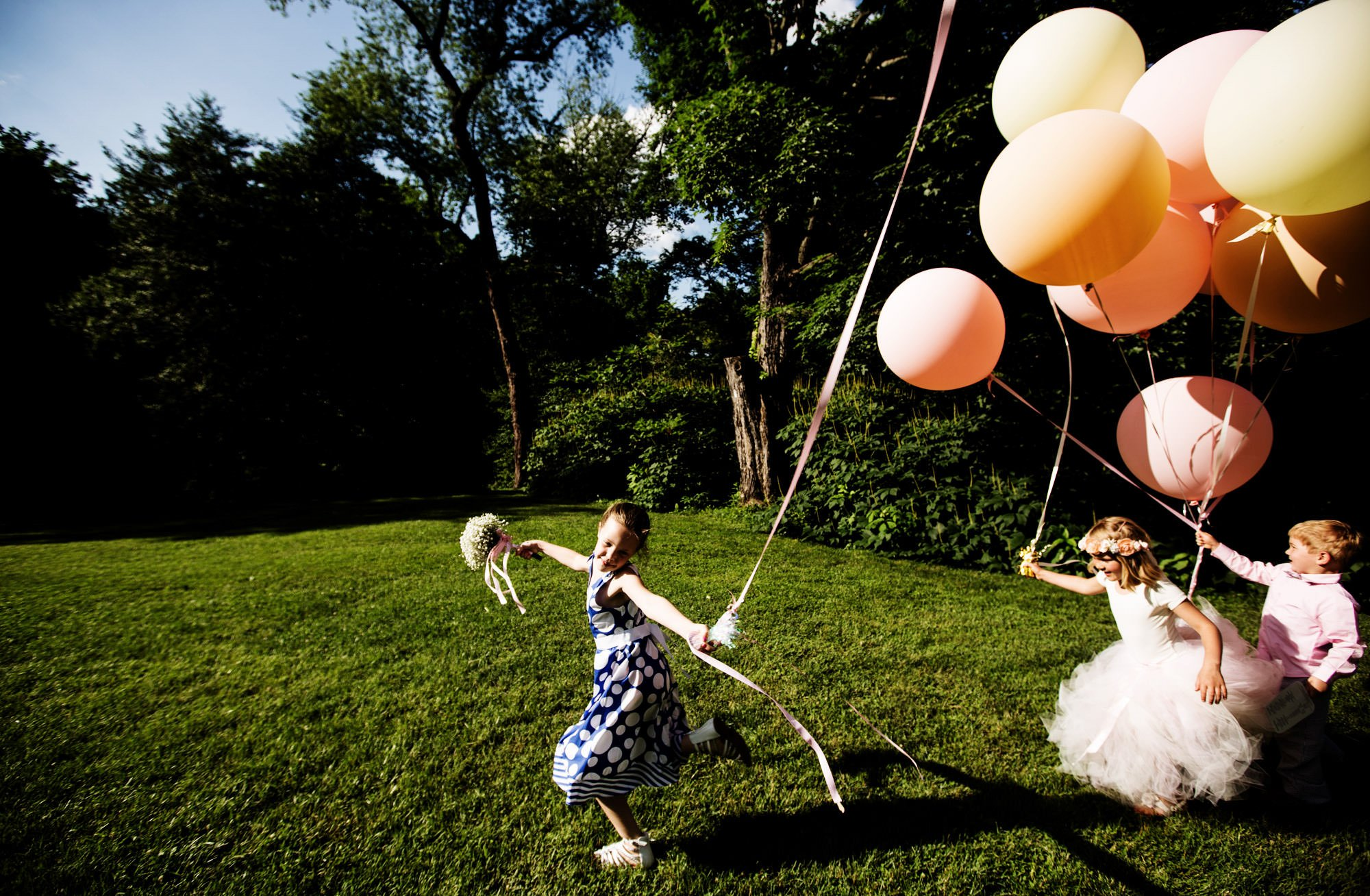 Children play with balloons on the grounds of Hendry House.