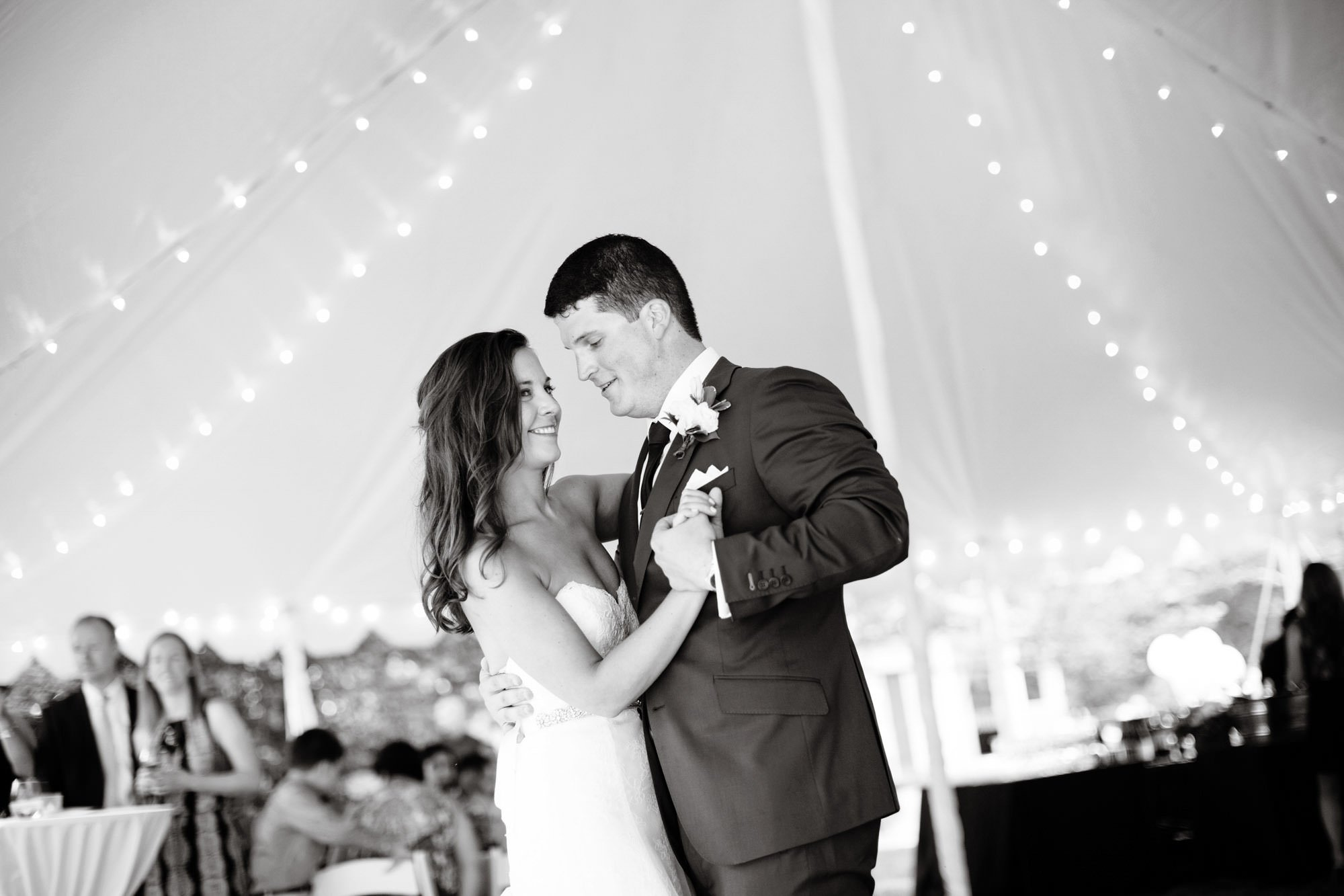 The couple shares their first dance as husband and wife during the tented wedding reception.