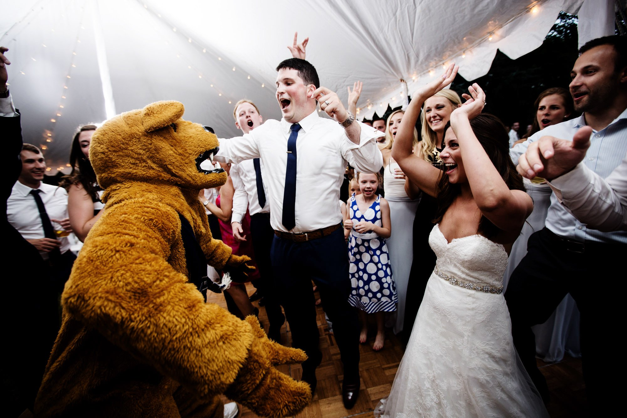 The Penn State Nittany Lion makes an appearance during the wedding reception at Hendry House.