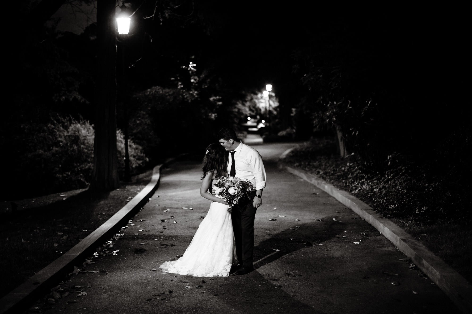 The couple kisses following their tented reception.