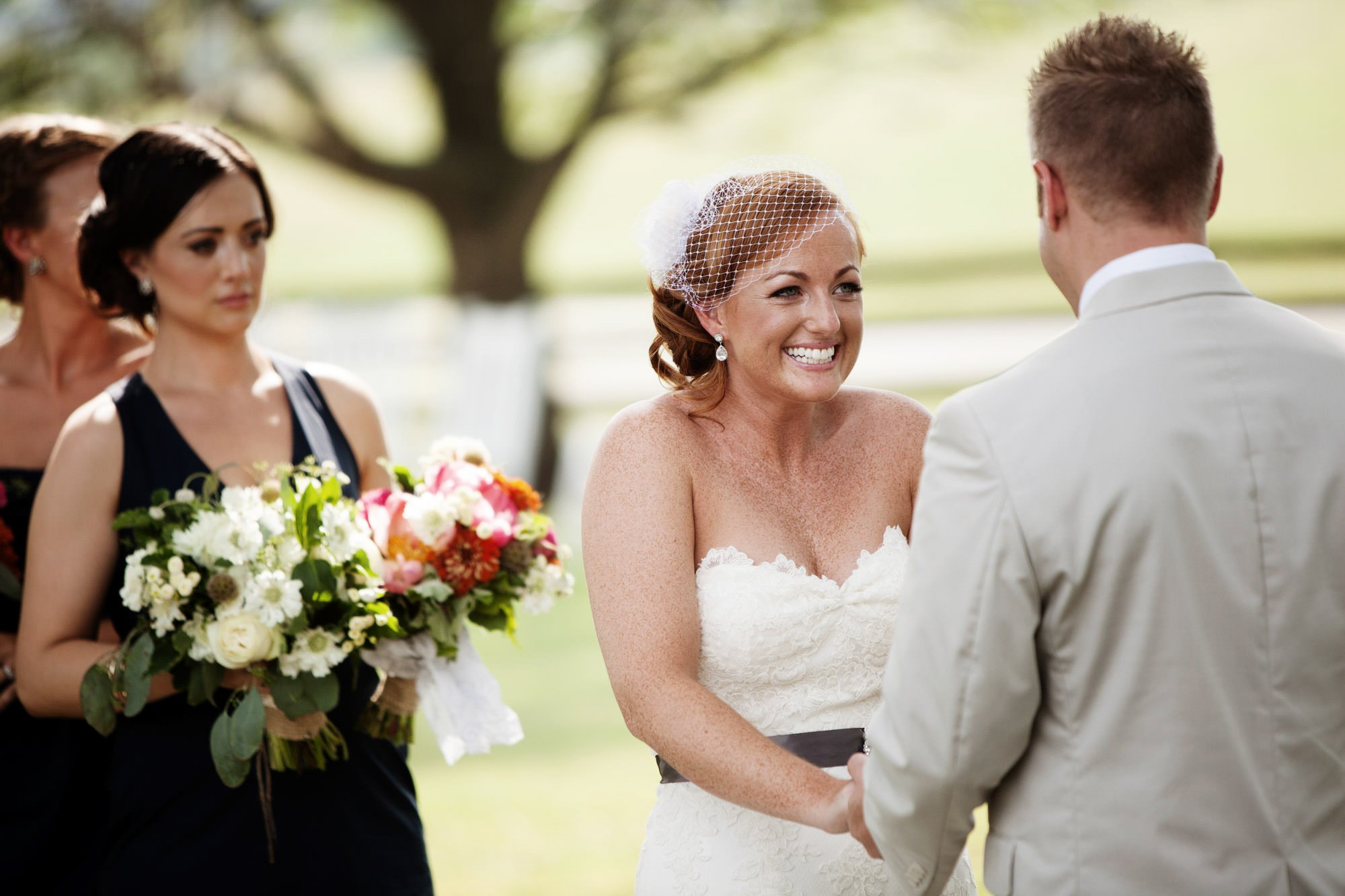 The bride smiles at her groom during the Marriott Ranch wedding ceremony.