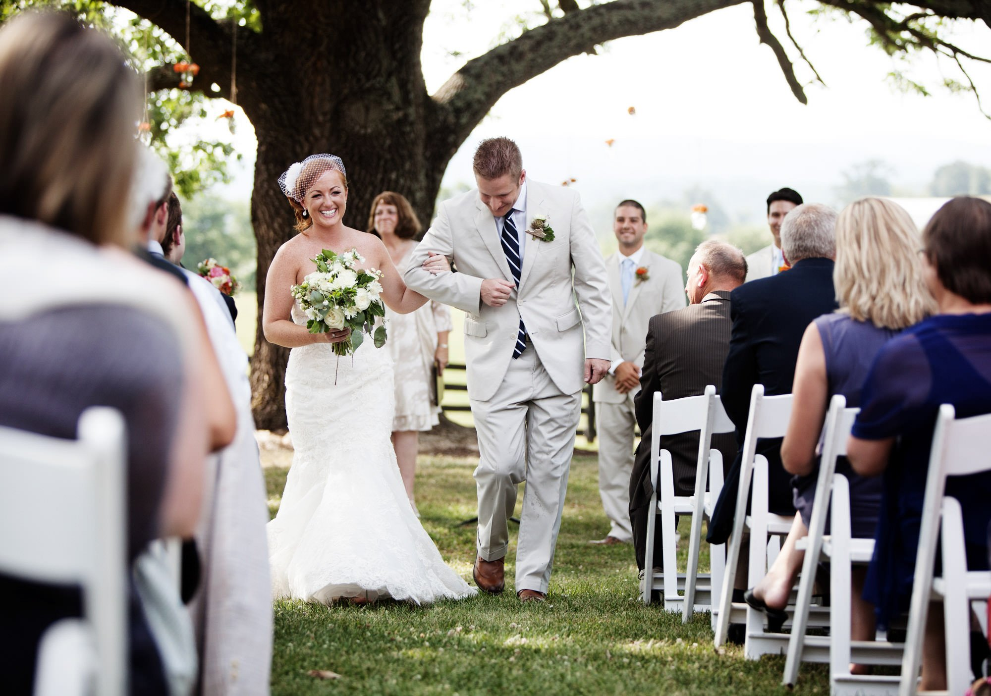 The couple walks down the aisle following the wedding ceremony at Marriott Ranch.