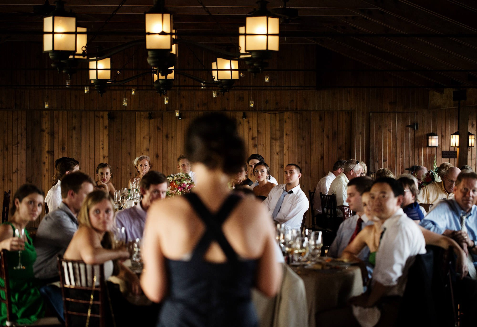 Guests listen to toasts during the wedding reception at Marriott Ranch.