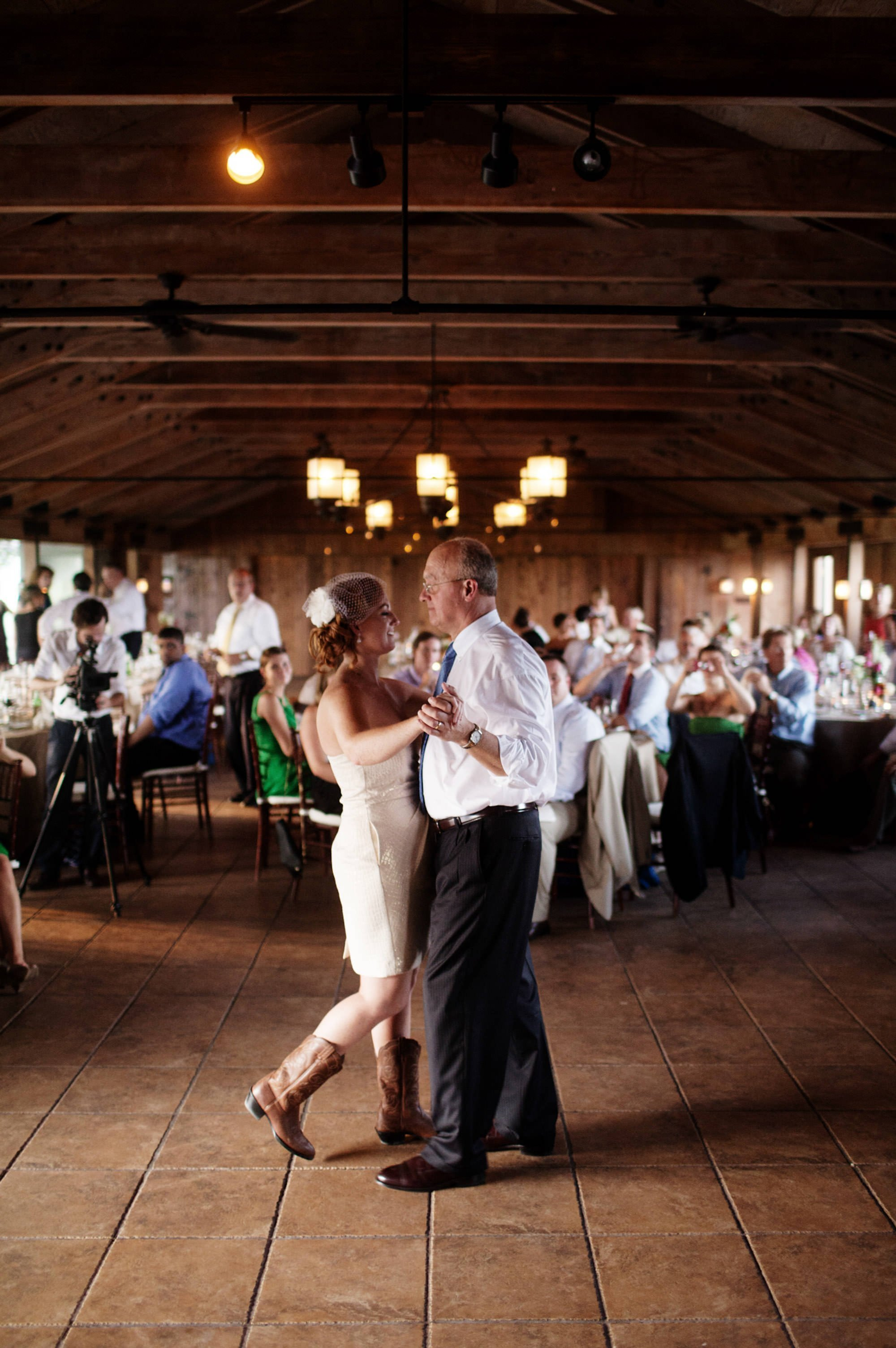 The bride dances with her father during the wedding reception at Marriott Ranch.