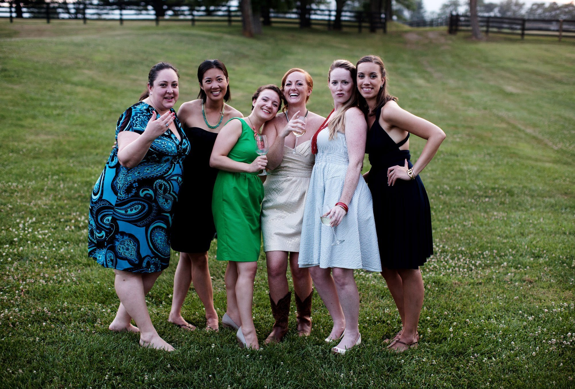 The bride poses with friends during her Marriott Ranch wedding reception.