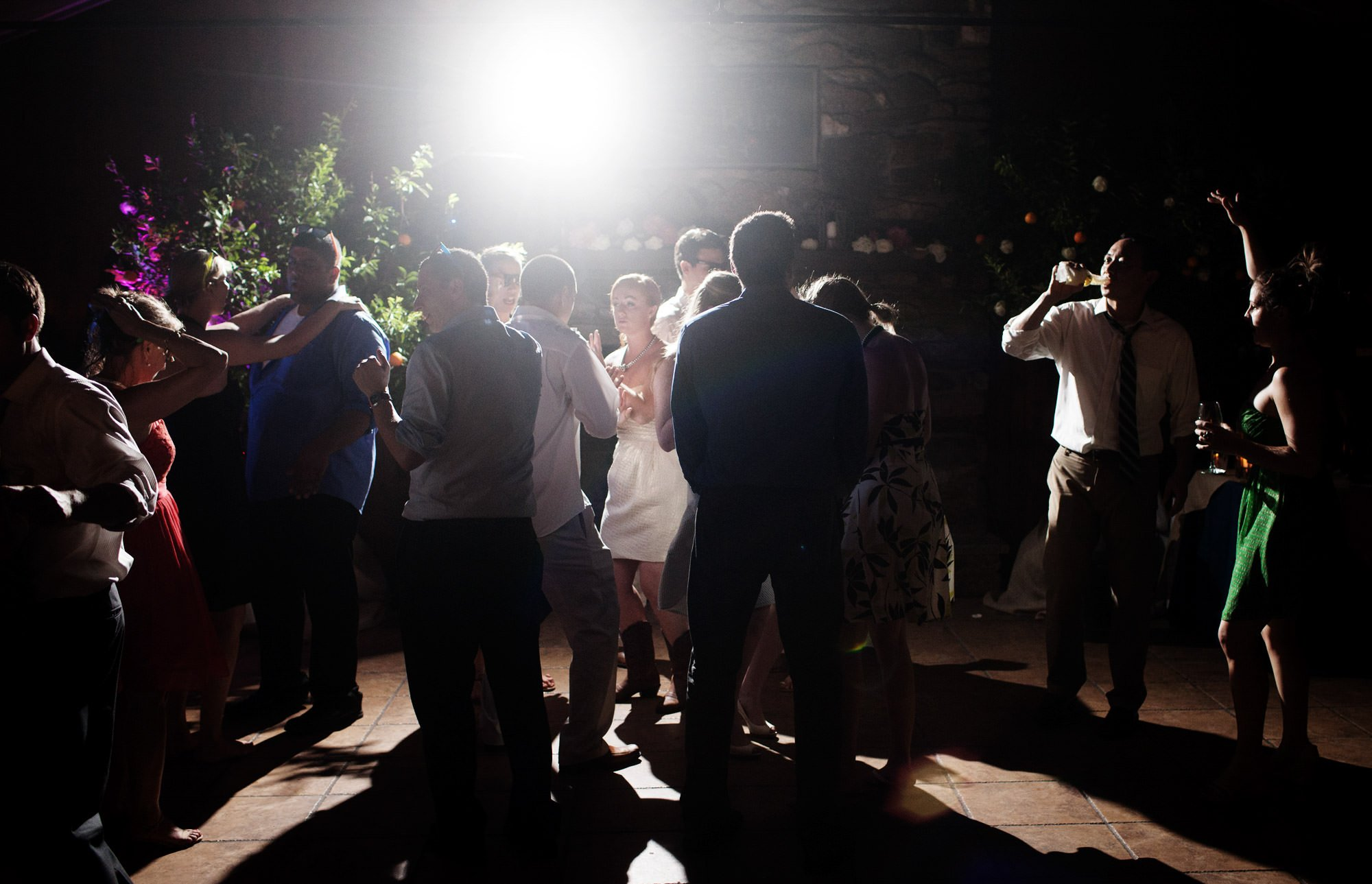 Guests dance during the wedding reception at Marriott Ranch.