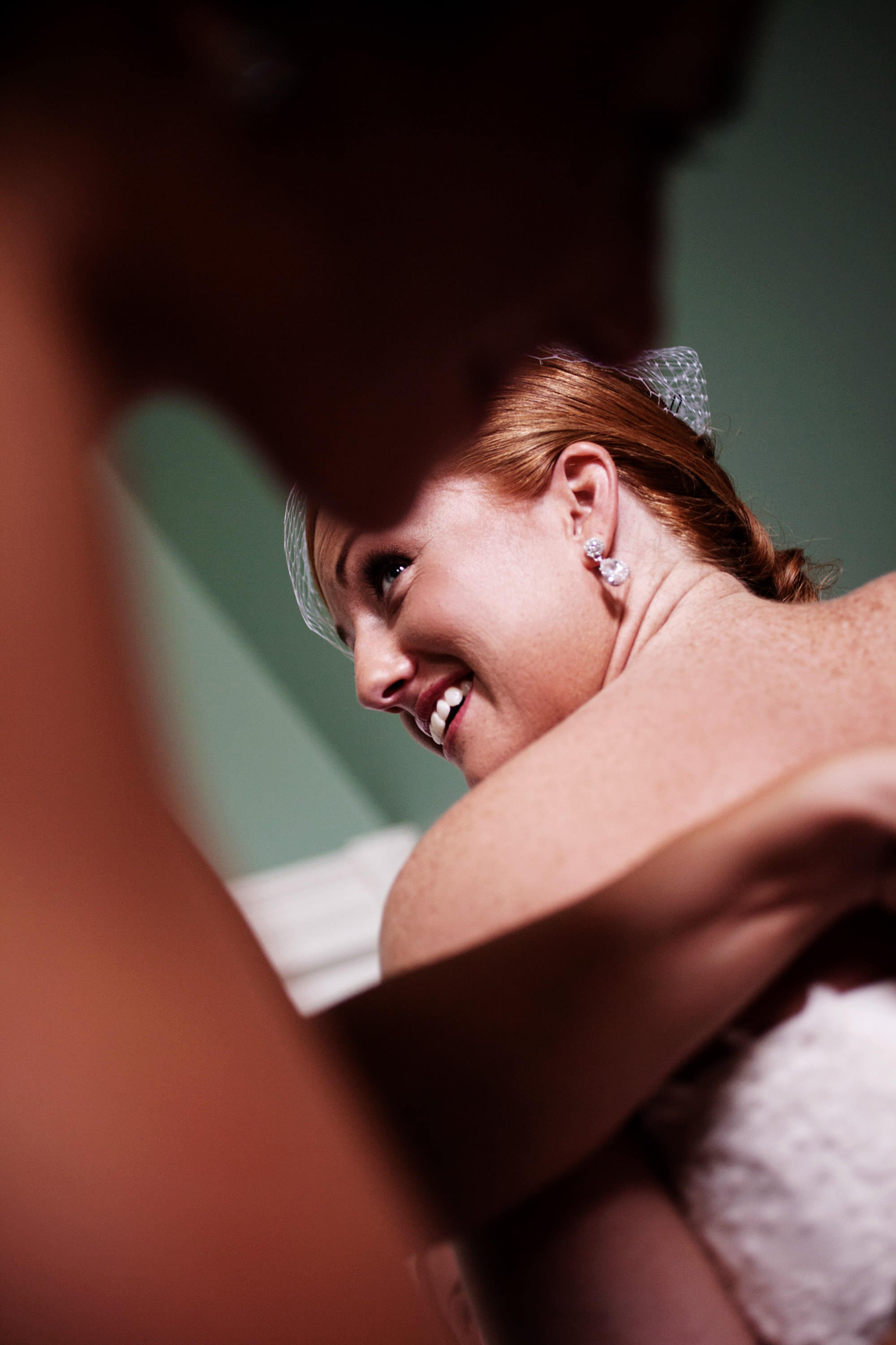 The bride puts on her wedding dress before her Marriott Ranch Wedding.