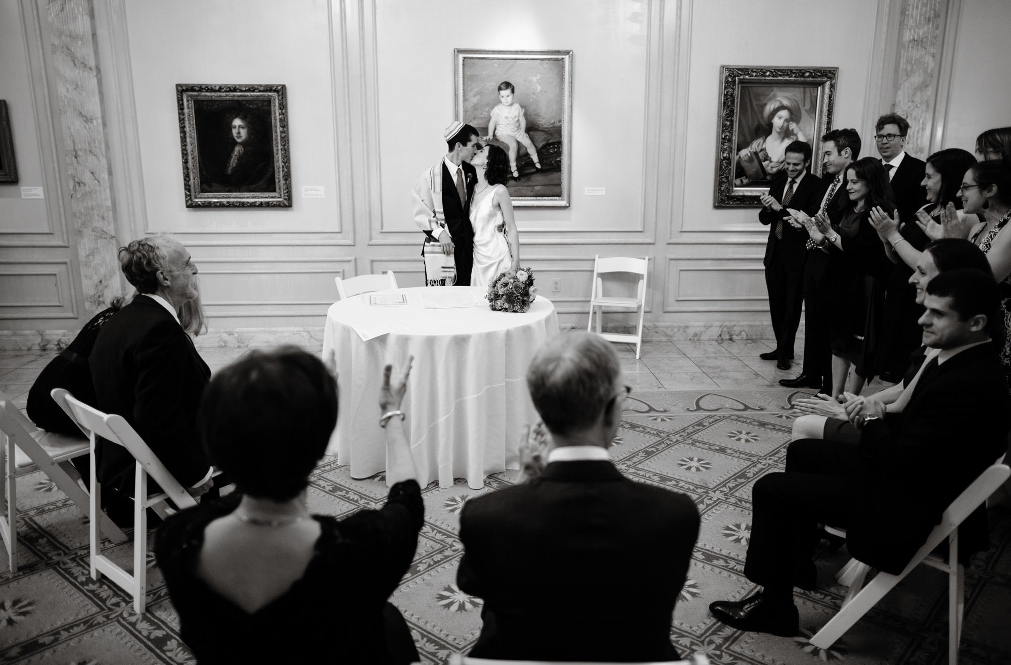The bride and groom share their first kiss following their ketubah signing at NMWA.