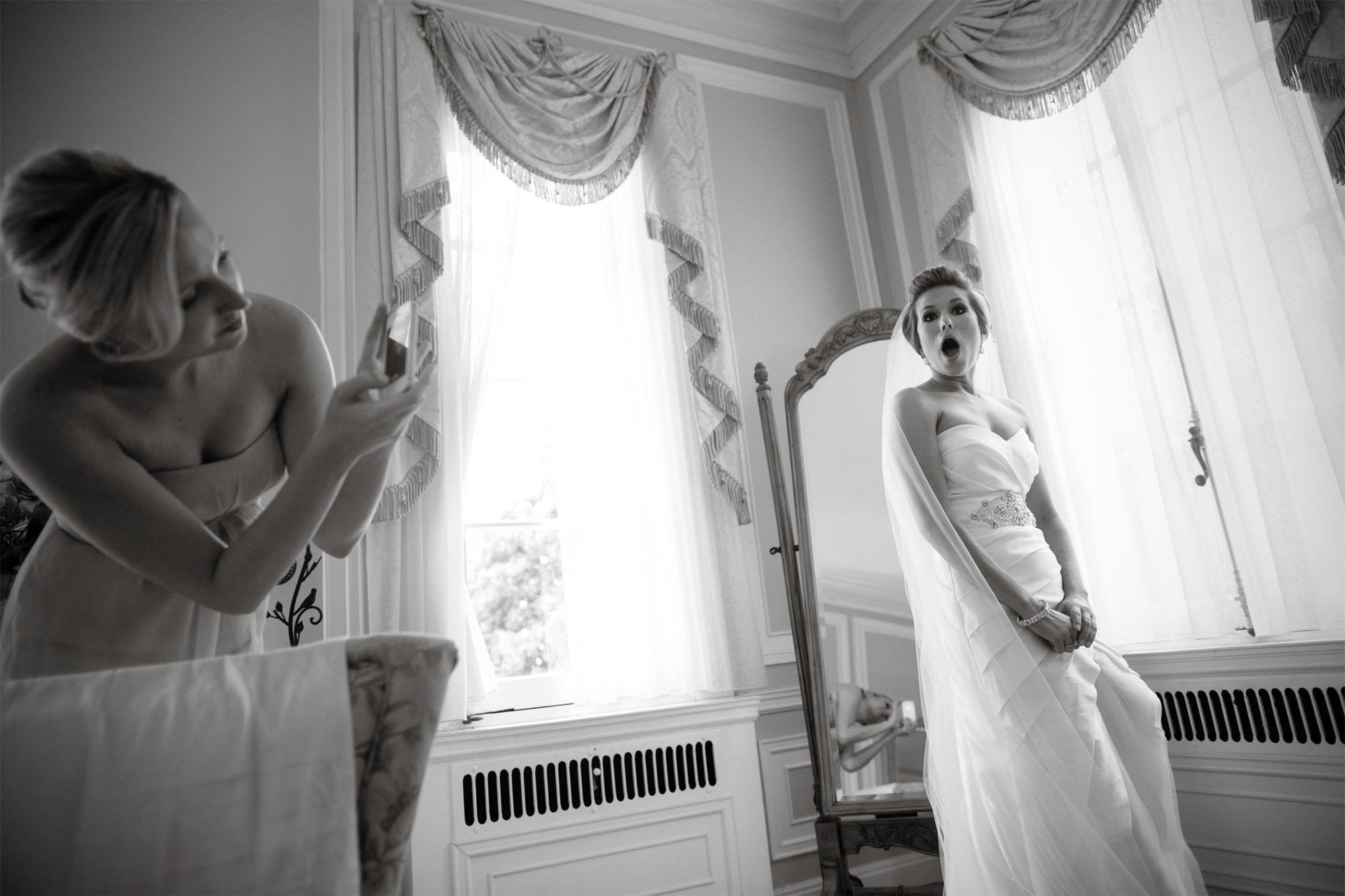 The bride reacts with shock before the ceremony on her Oxon Hill Manor wedding day.