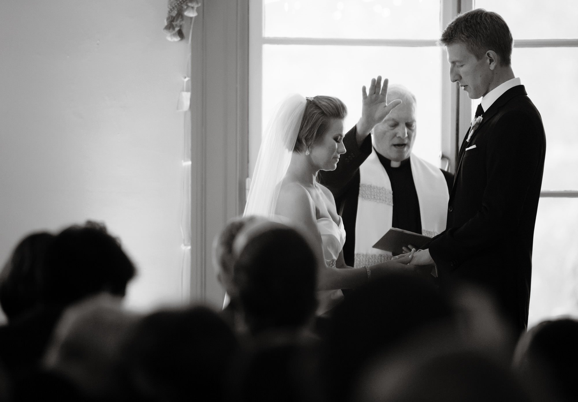 The bride and groom pray during the wedding ceremony.