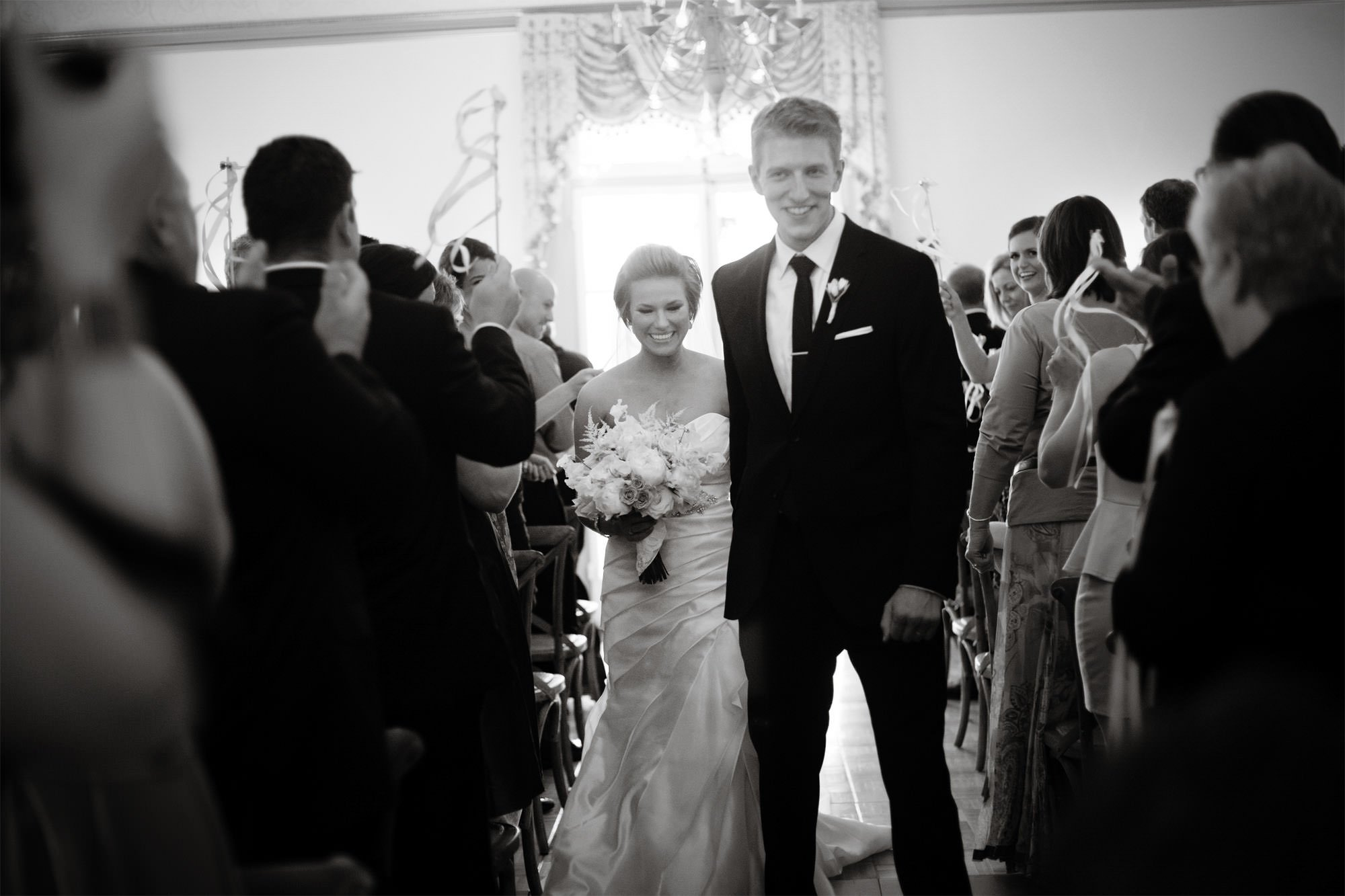 The bride and groom walk down the aisle together following their wedding ceremony at Oxon Hill Manor.