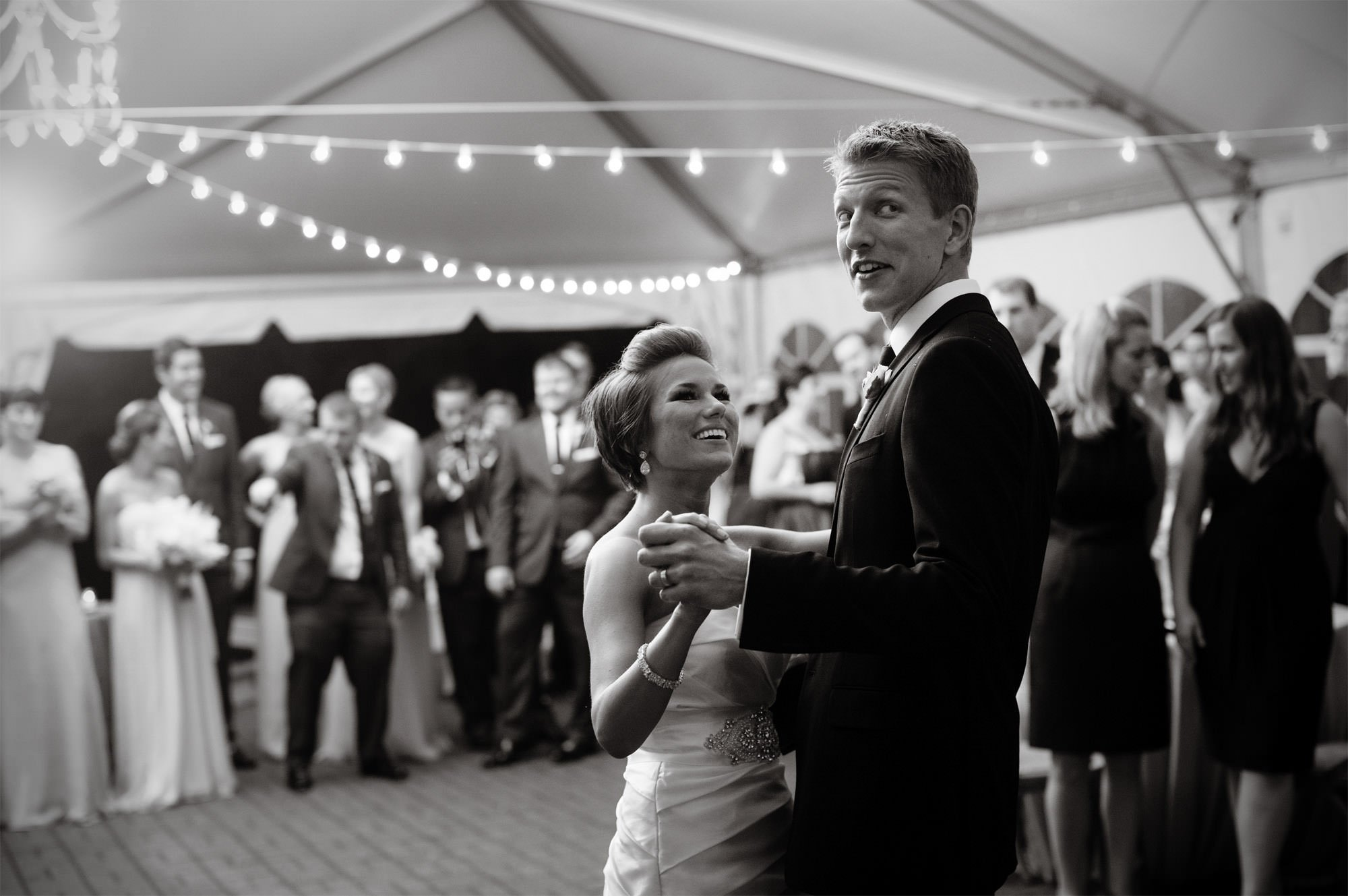 The bride and groom dance during the tented reception of their Oxon Hill Manor wedding in Oxon Hill, MD.