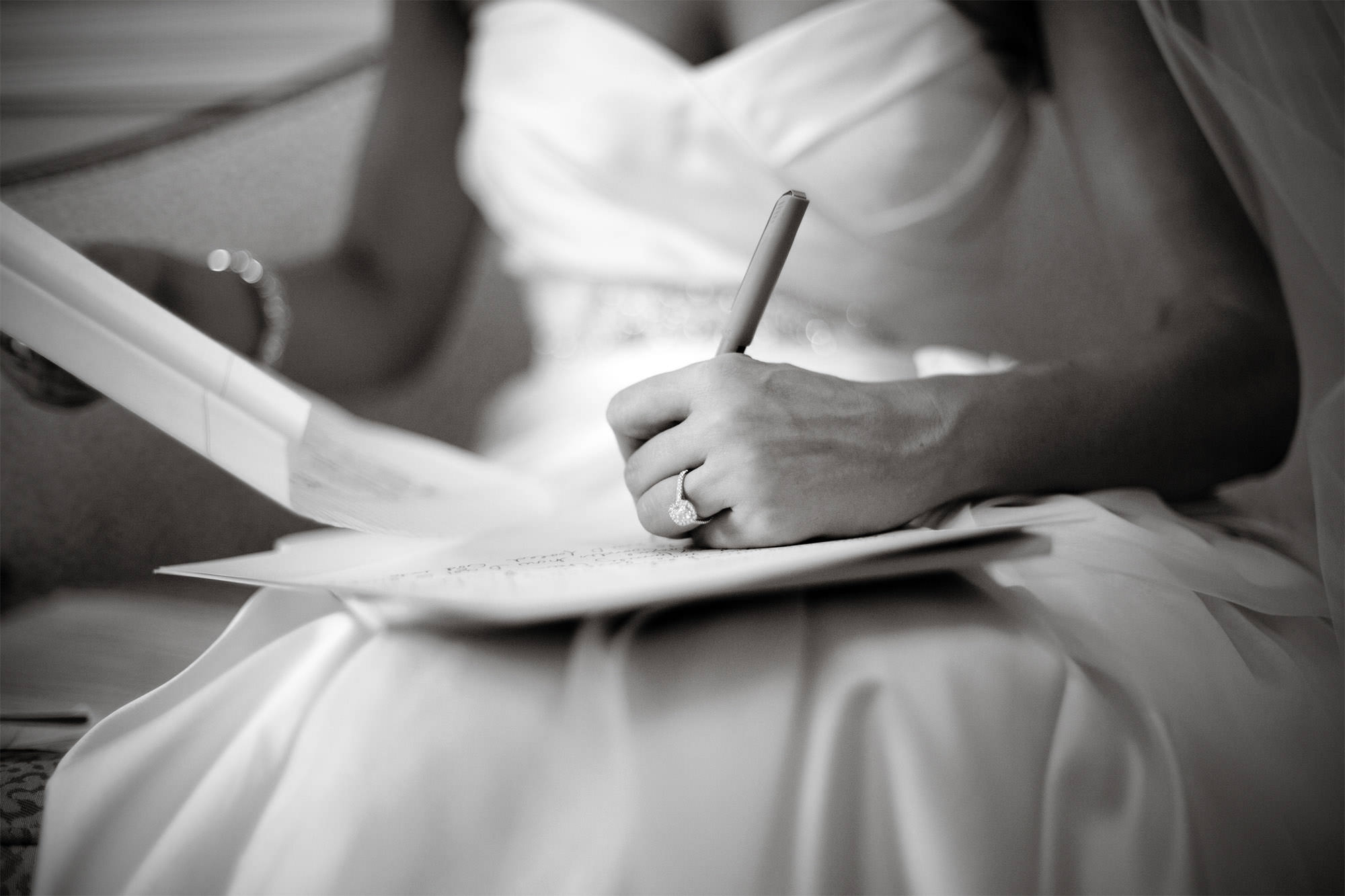 The bride writes her wedding vows at Oxon Hill Manor.