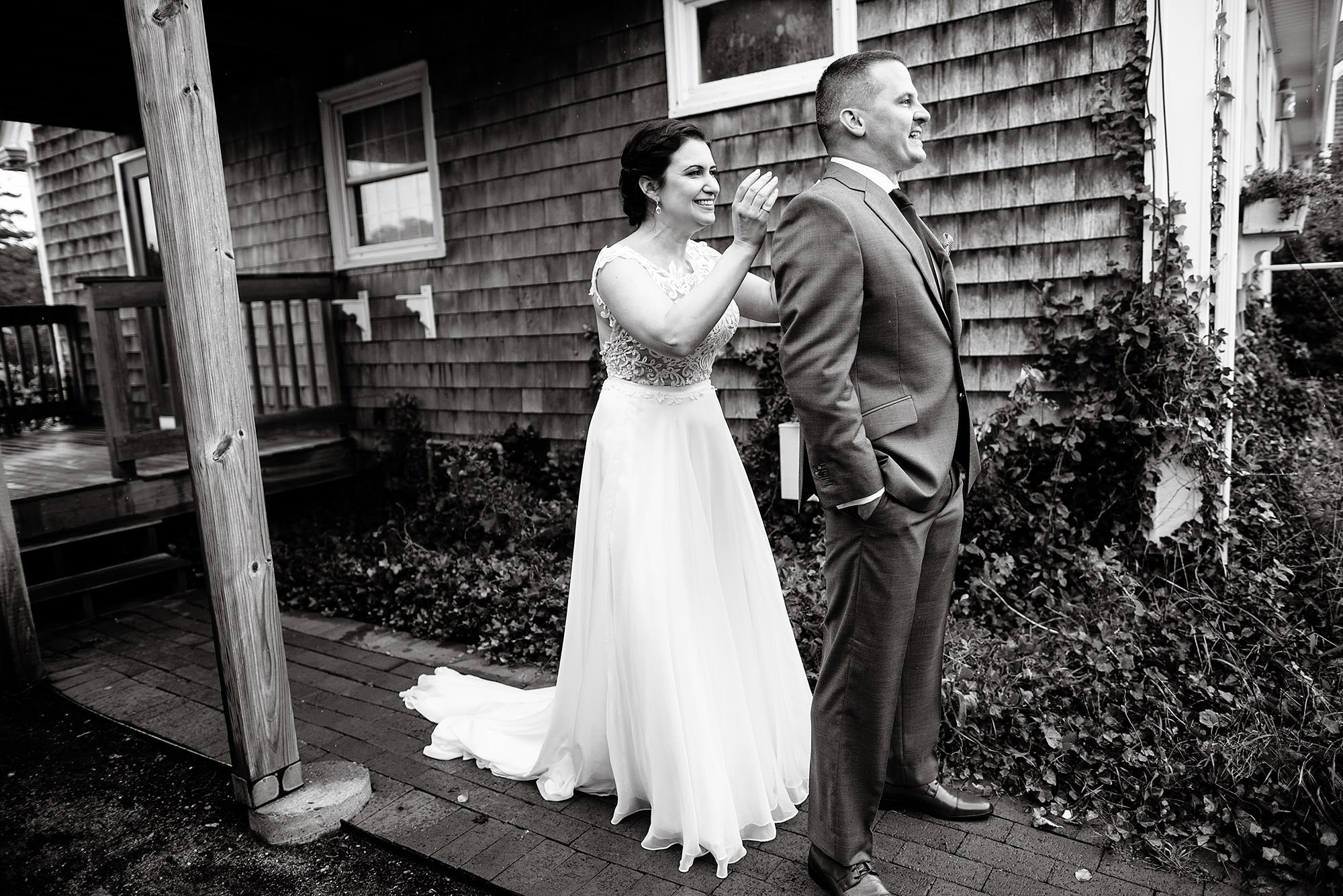 The bride and groom share their first look before the wedding ceremony at Pelham House Resort.