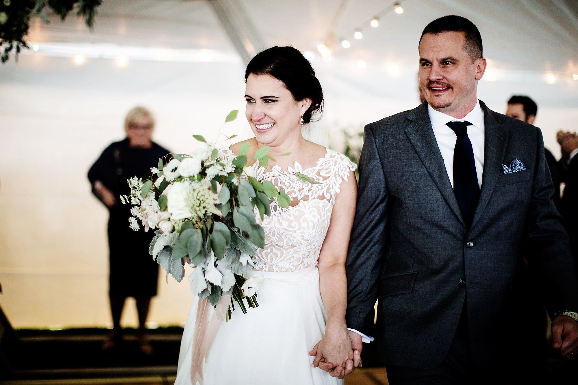 The couple walks down the aisle during their Pelham House Resort wedding.