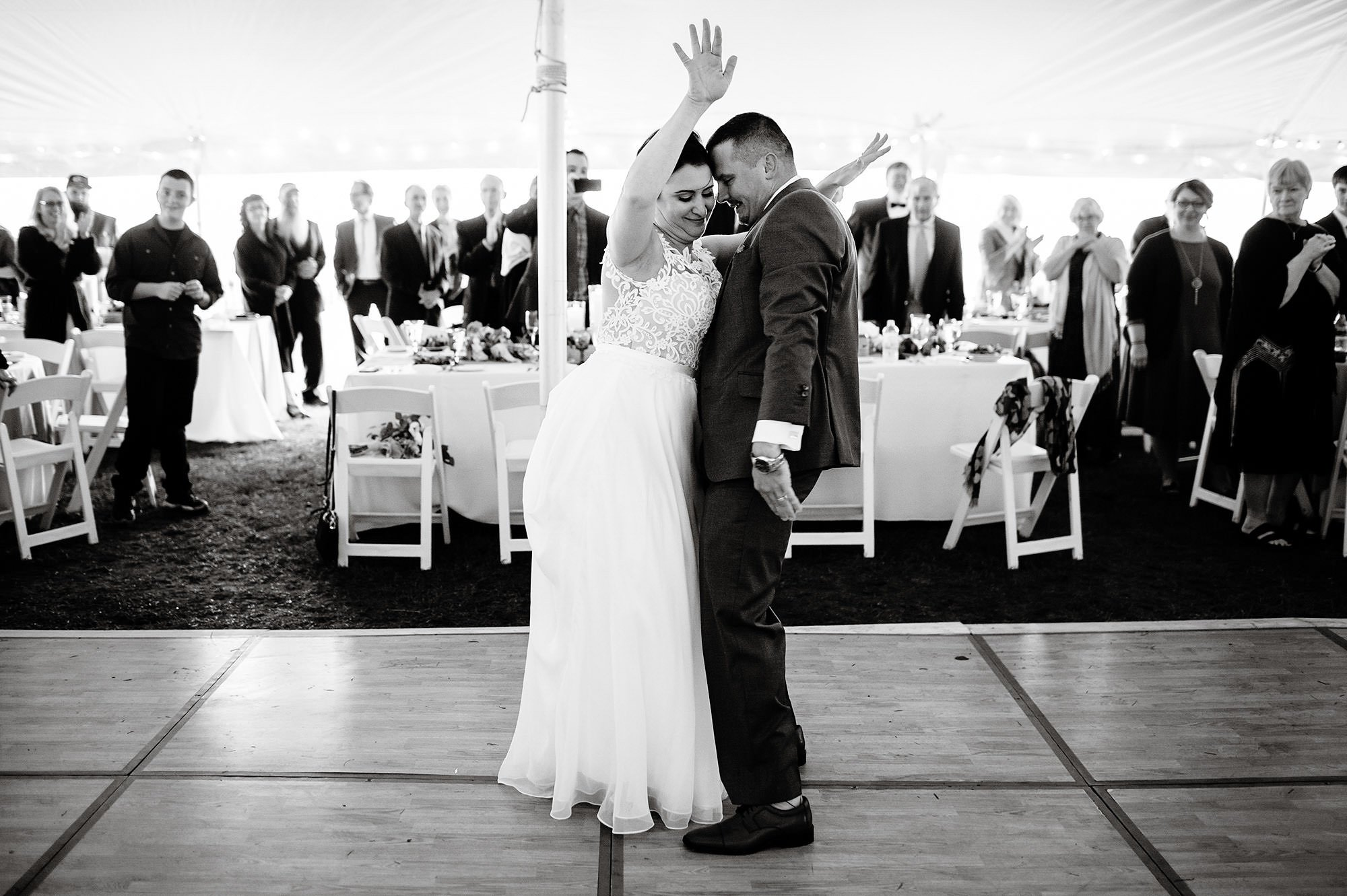 The bride and groom share their first dance during their Pelham House Resort wedding on Cape Cod.