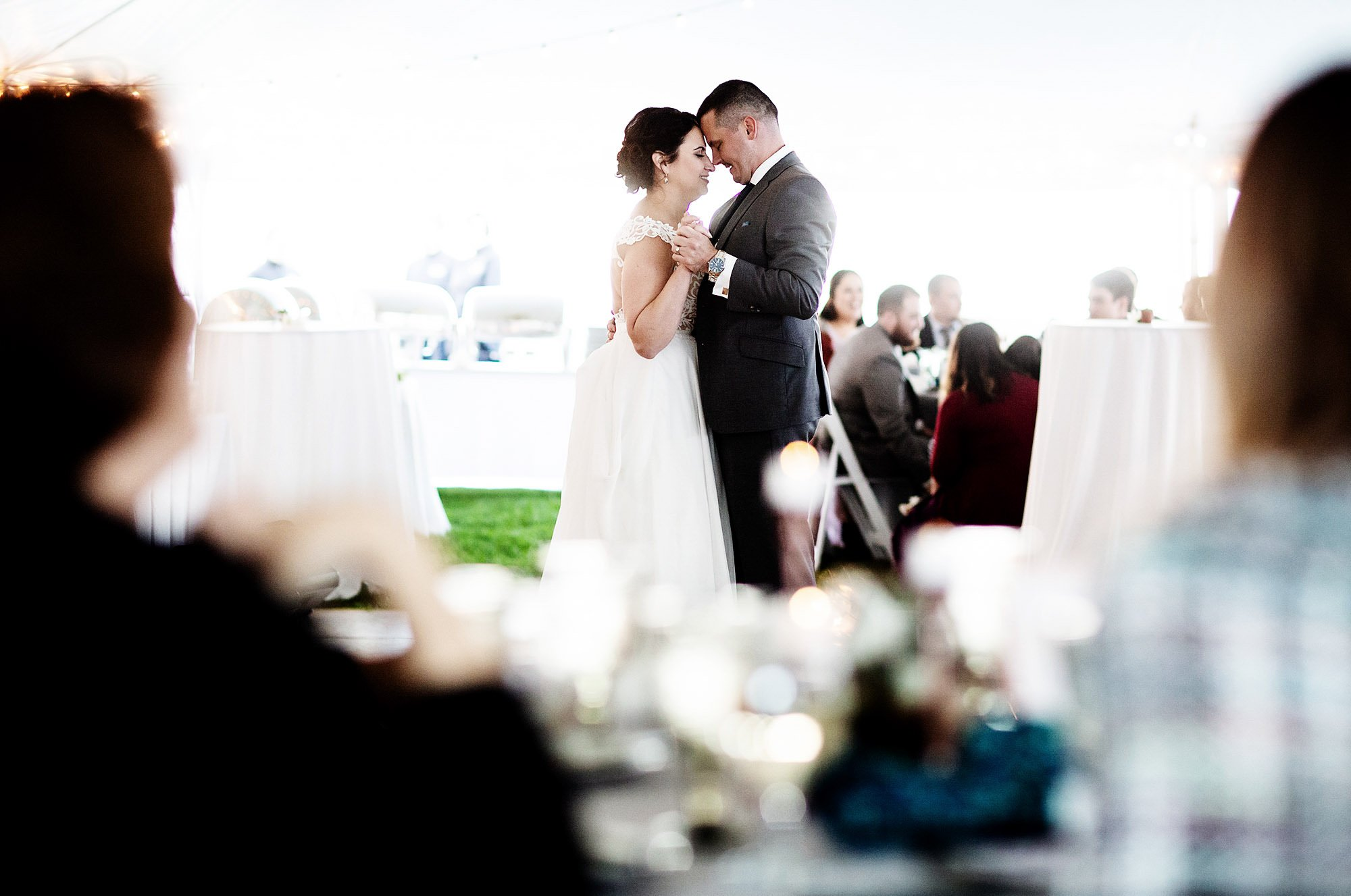 The bride and groom share their first dance during their Pelham House Resort wedding.