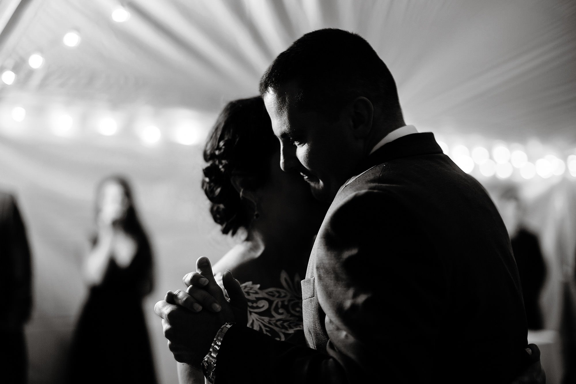 The groom dances with his bride at the tented wedding reception at Pelham House Resort.