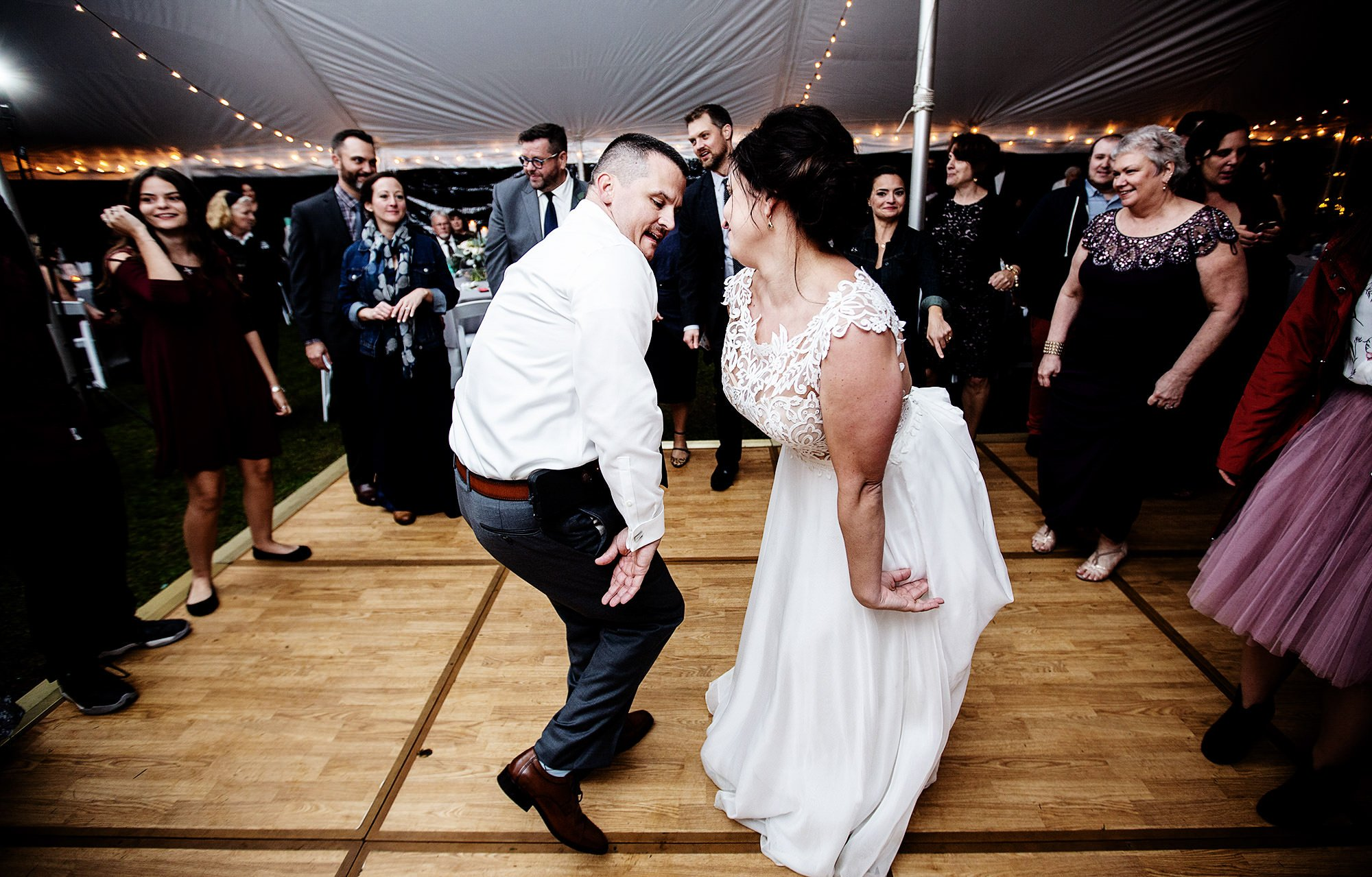 The bride and groom dance during their tented wedding reception at Pelham House Resort.