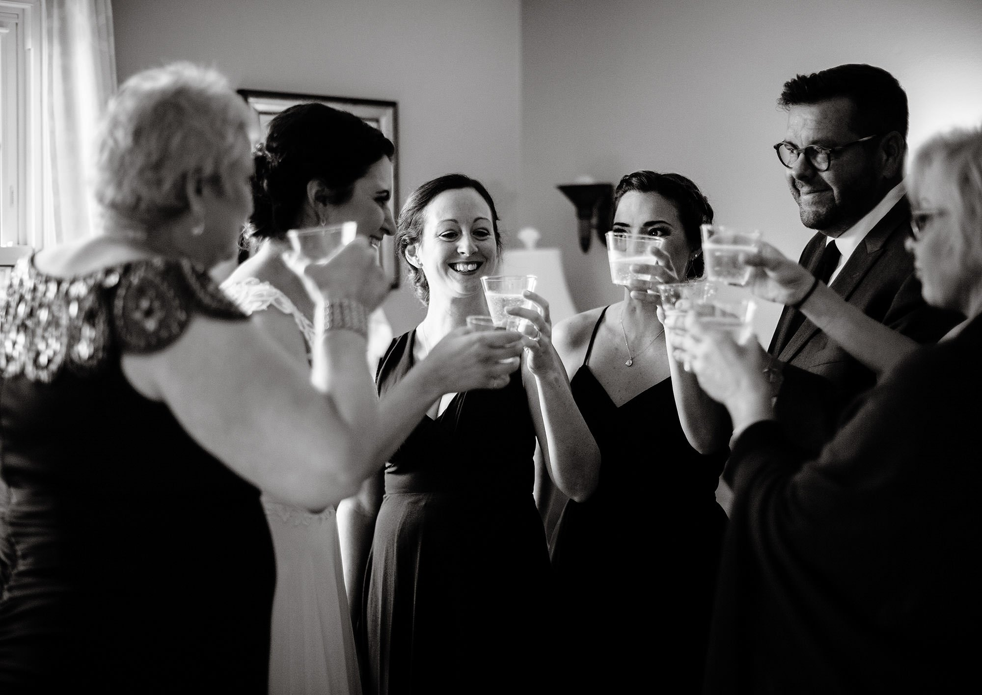 The bridal party gives a toast prior to the wedding ceremony at Pelham House Resort.