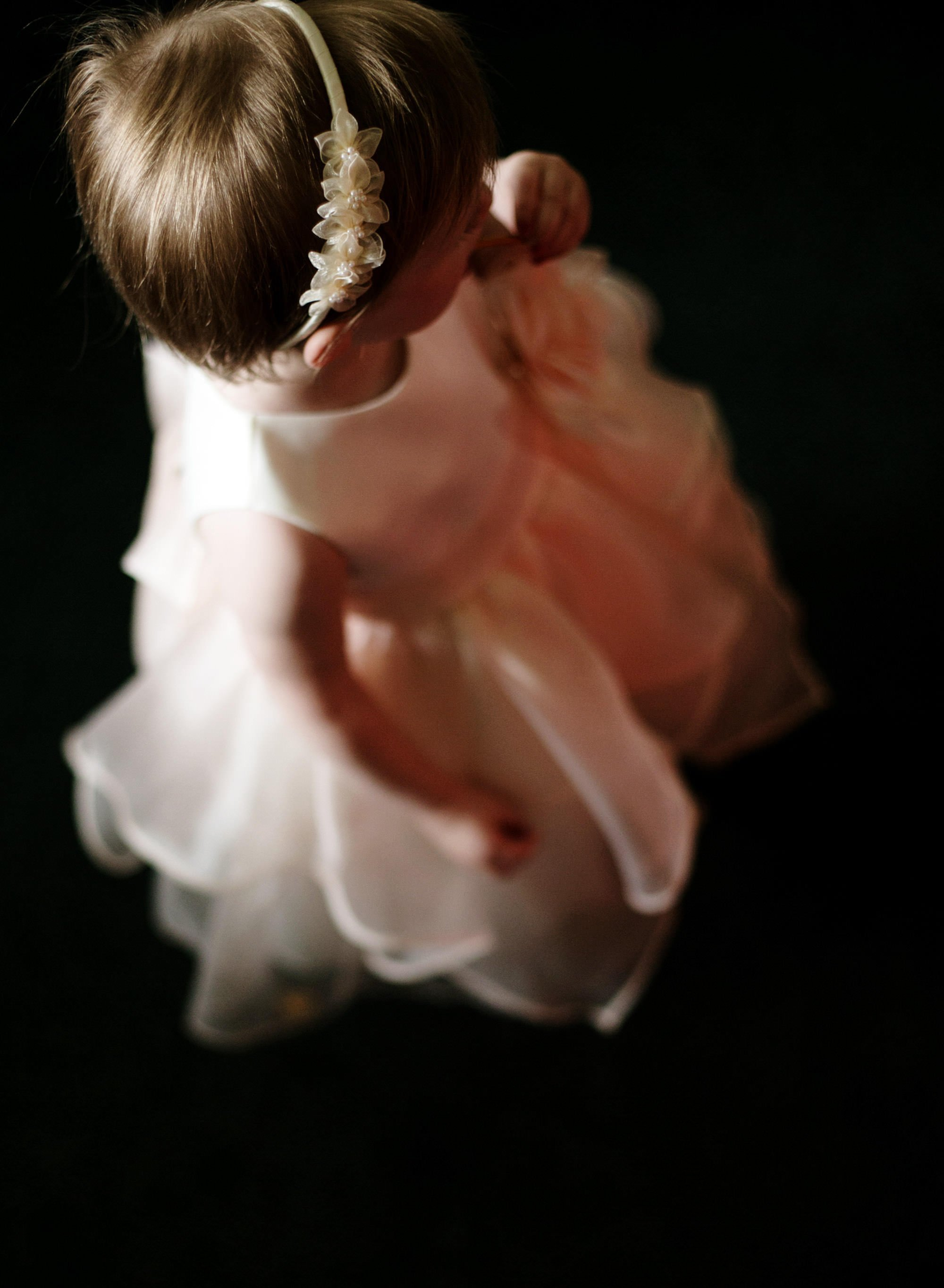 A flower girl waits for the wedding ceremony to begin at River Farm.