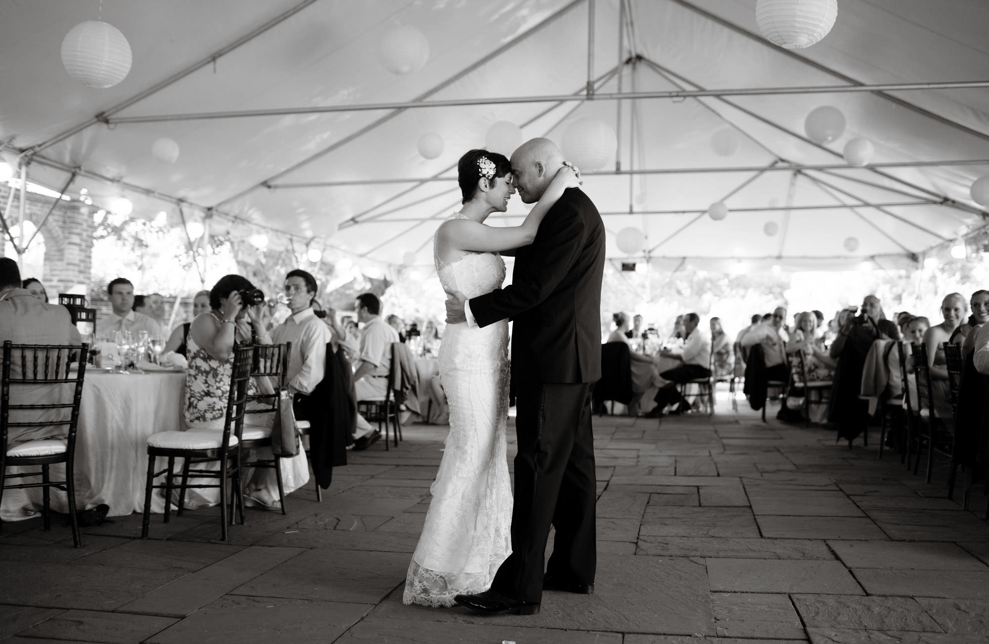 The bride and groom share their first dance during their River Farm wedding.