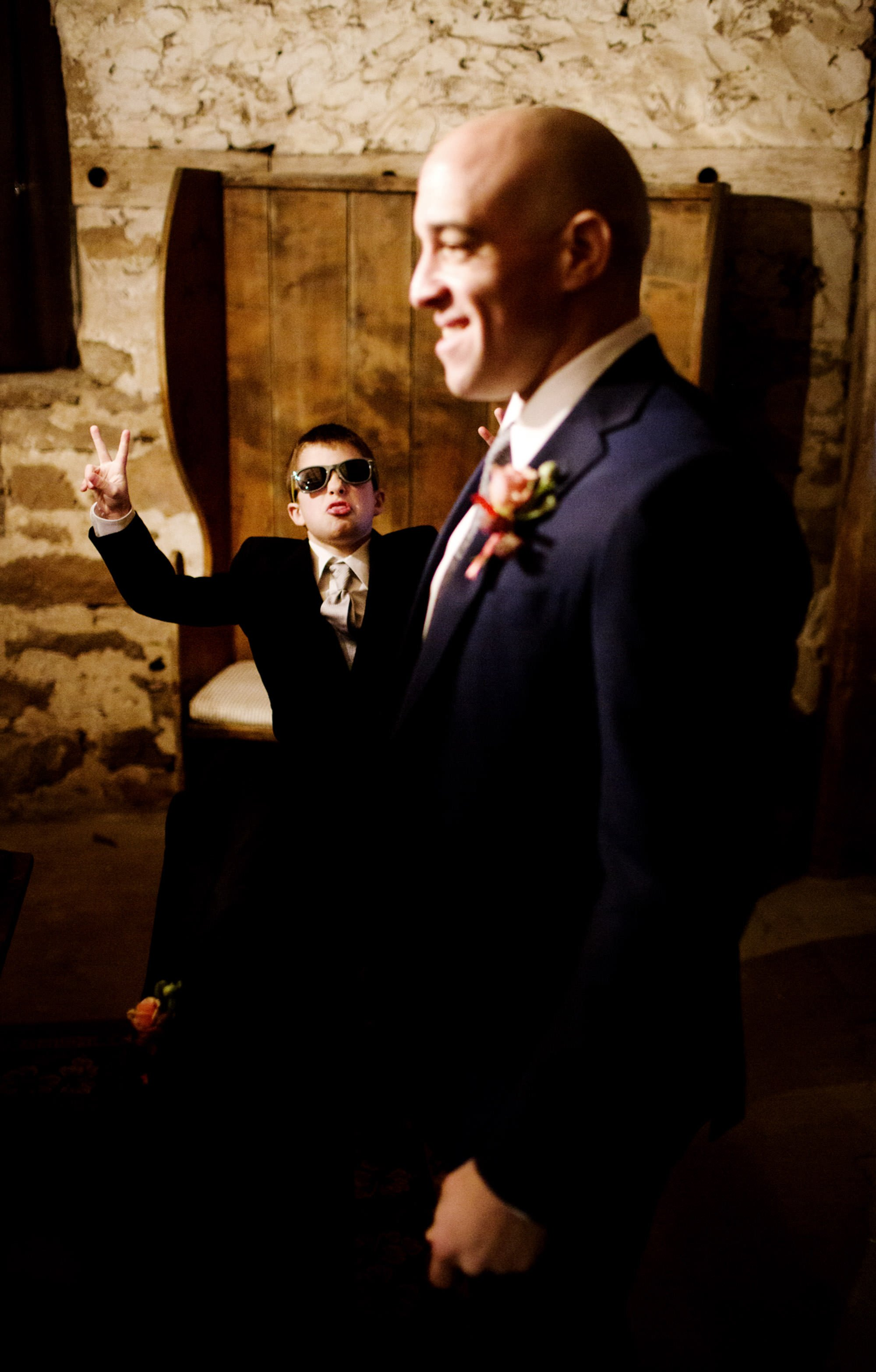 The ring bearer goofs off prior to the wedding ceremony.