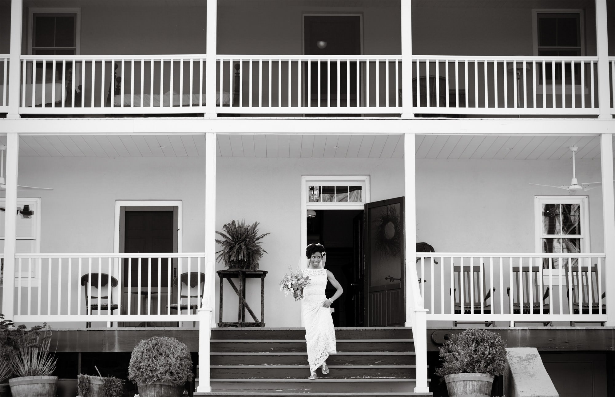 The bride walks down the steps of the Riverside on the Potomac farmhouse.