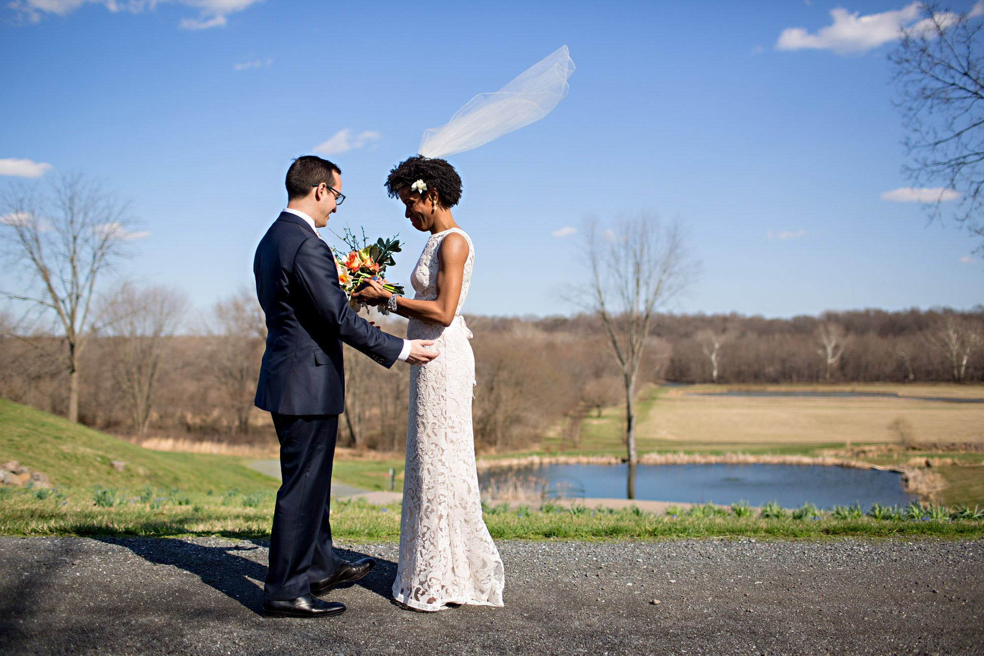 The bride and groom share their first look on the Riverside on the Potomac grounds.
