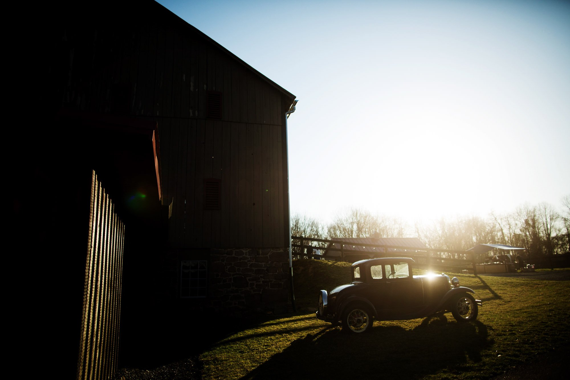 The sun sets on the antique car on the grounds of Riverside on the Potomac.