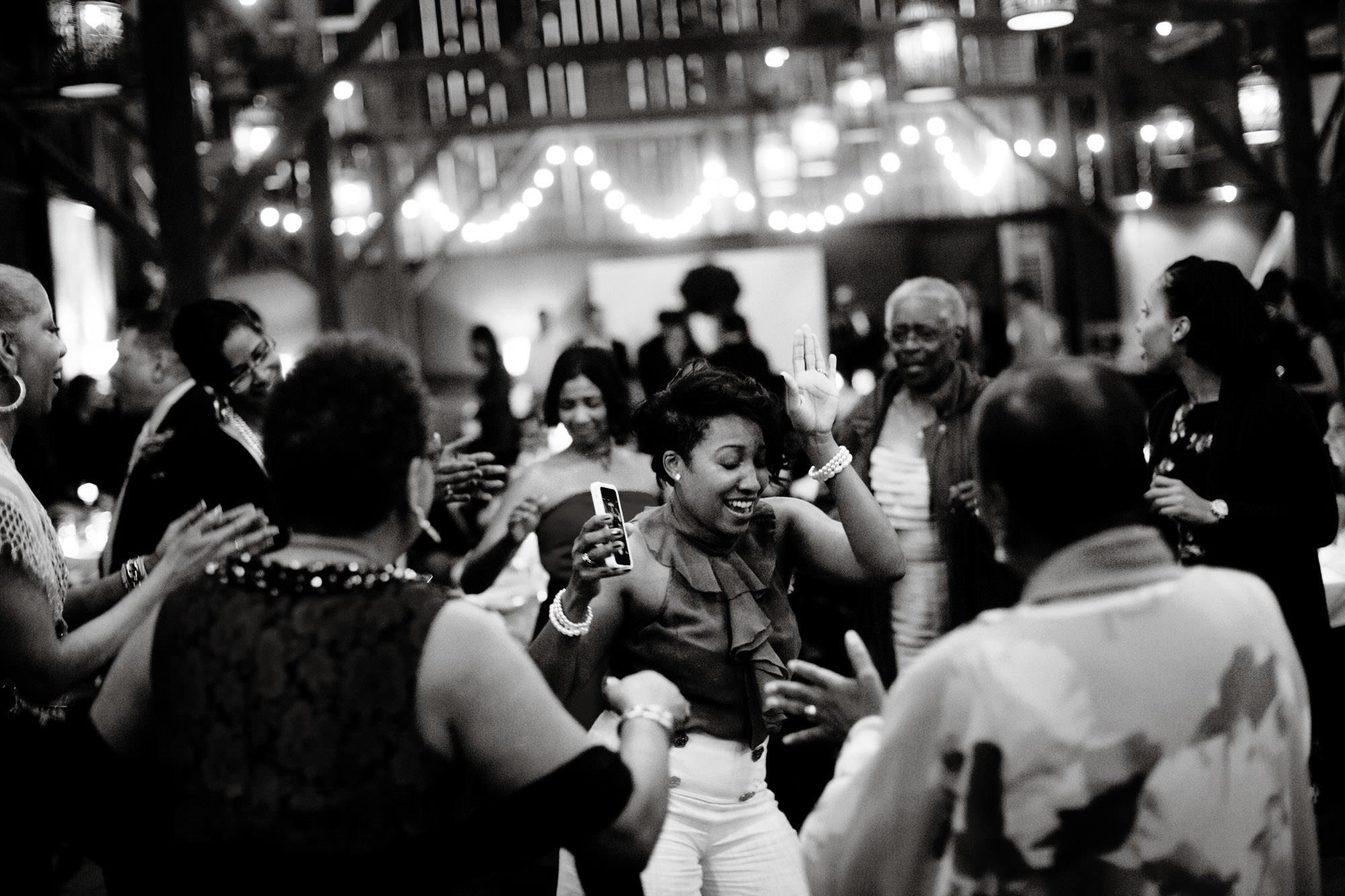 Guests enjoy the wedding reception by dancing.