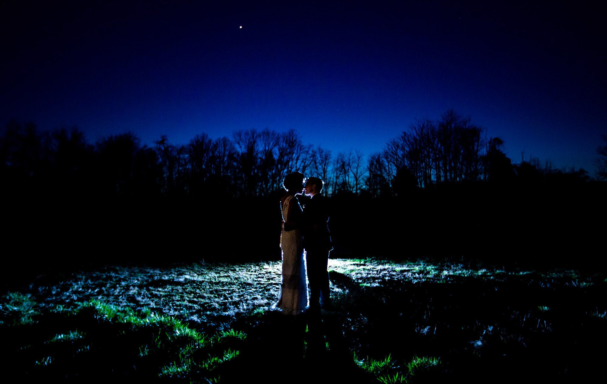 A portrait of the bride and groom once the sun has set.