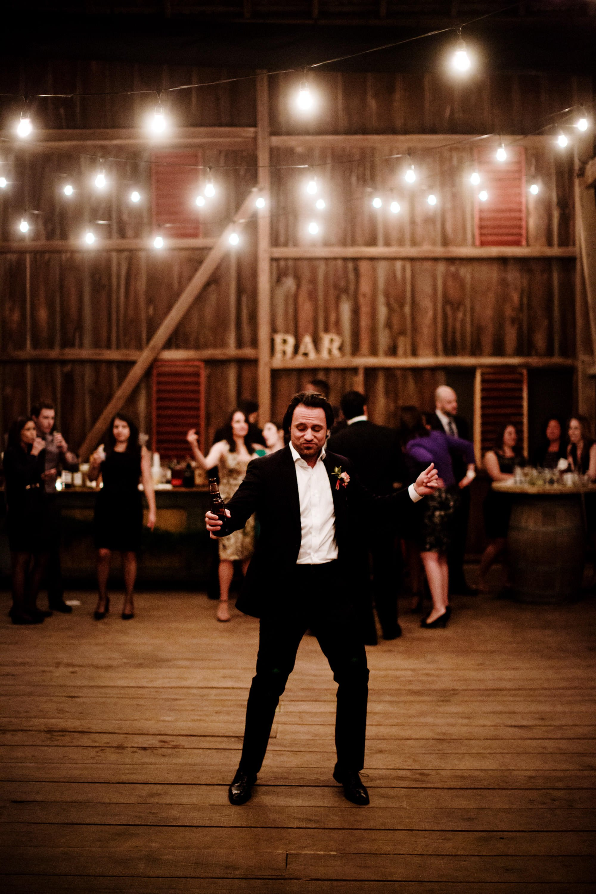 Guests dance in the barn during the reception at Riverside on the Potomac.