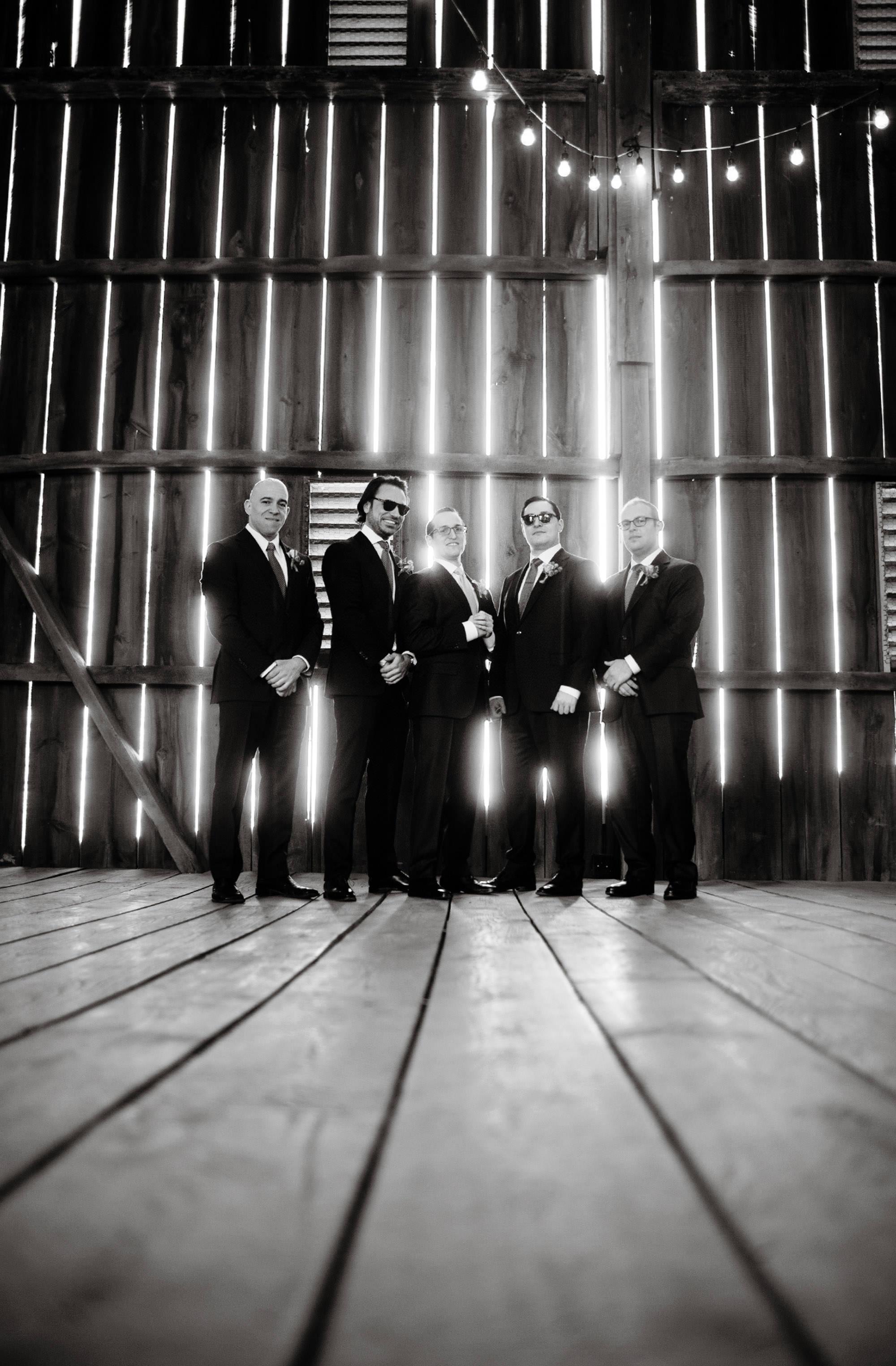 The groomsmen pose in the barn of Riverside on the Potomac.