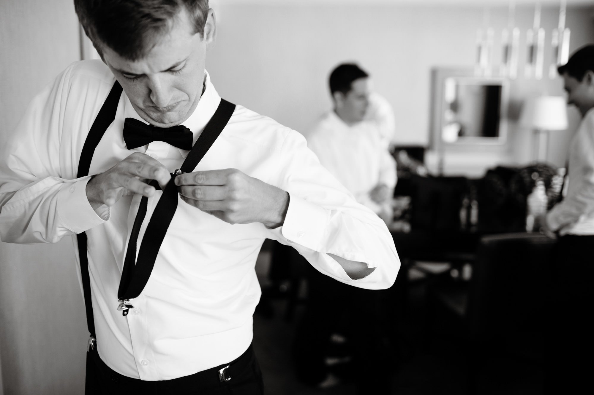 The groomsmen get ready at their hotel prior to the ceremony.