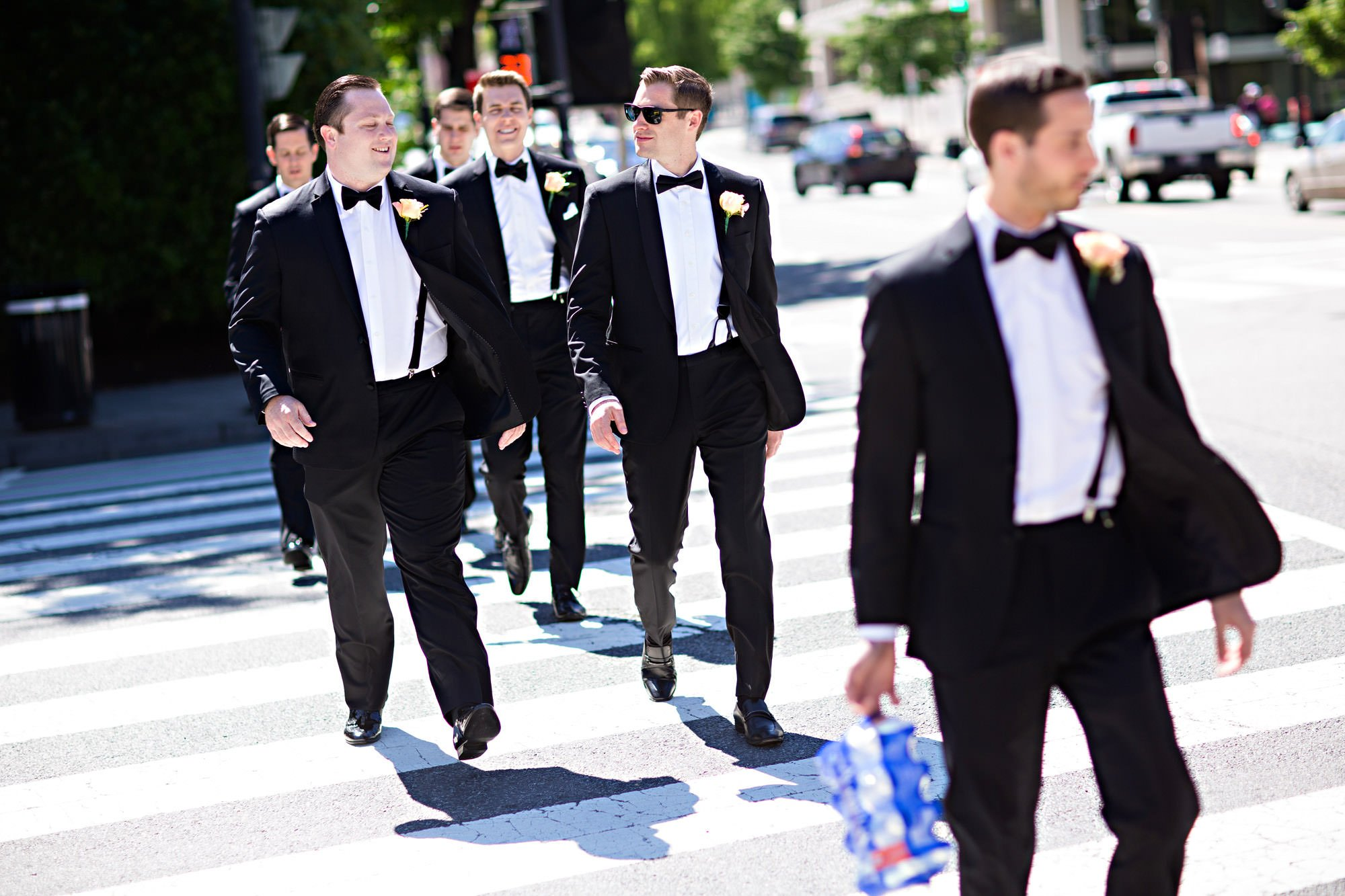 The groomsmen walk through a crosswalk in Washington, DC prior to the wedding ceremony.