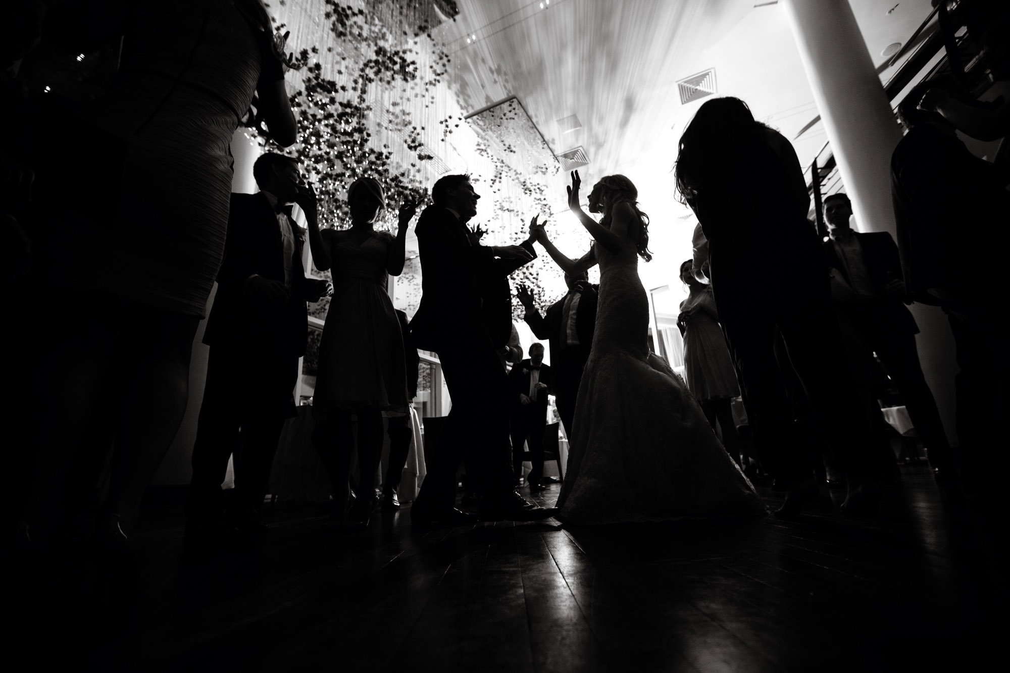 Guests dance during the wedding reception.
