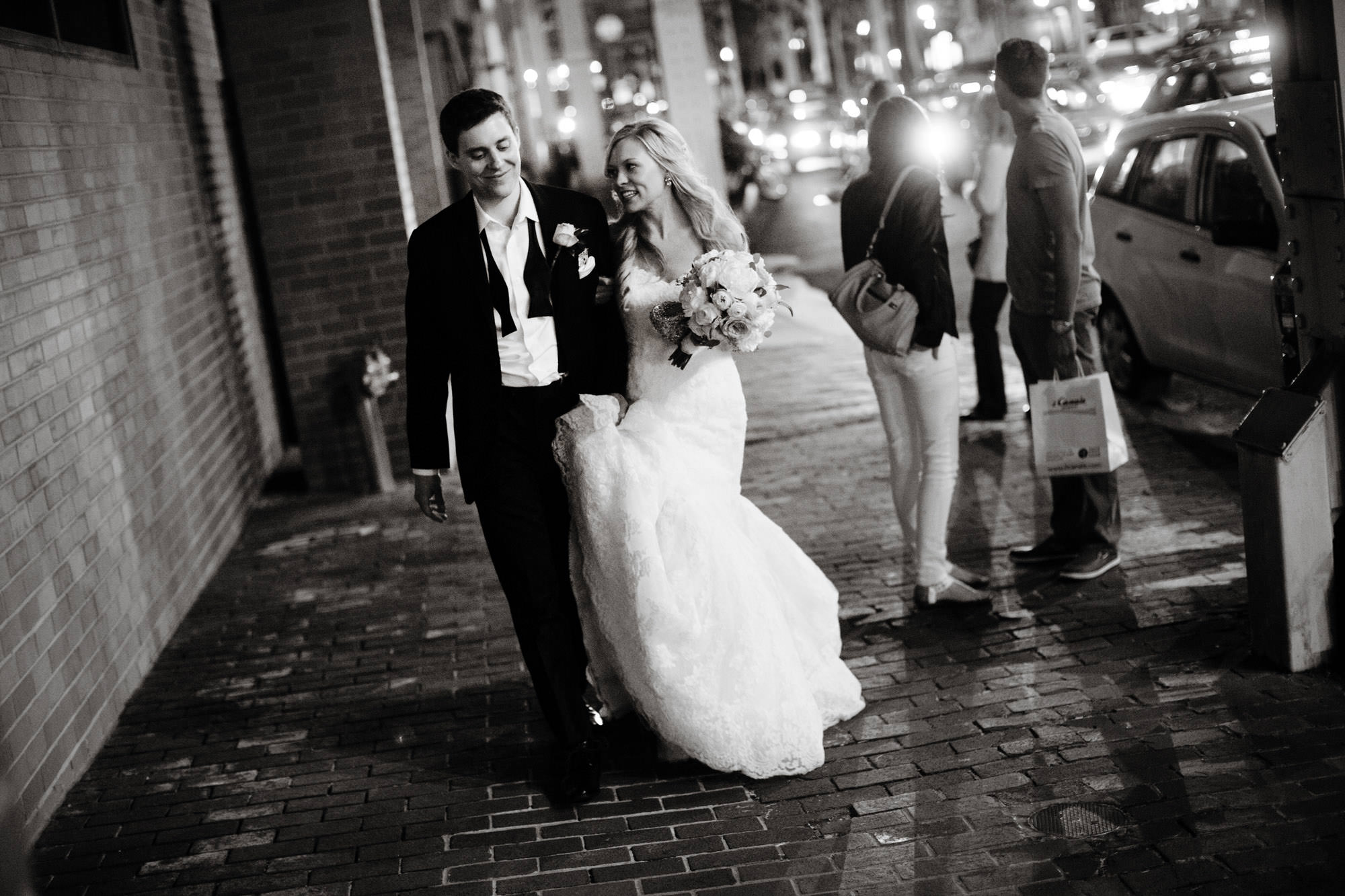 The bride and groom walk through Georgetown in Washington, DC following their Sequoia DC wedding.