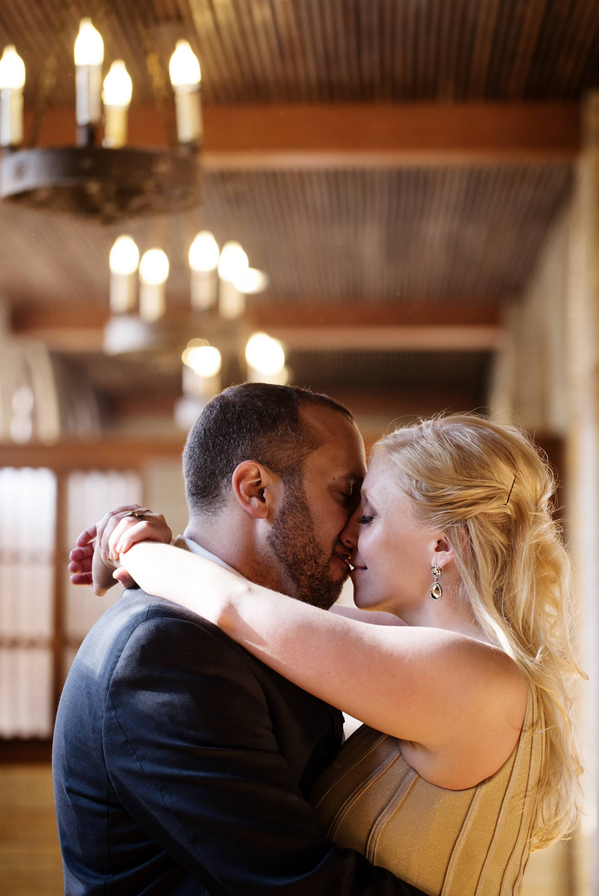 The couple kisses after the wedding ceremony at St Francis Hall.