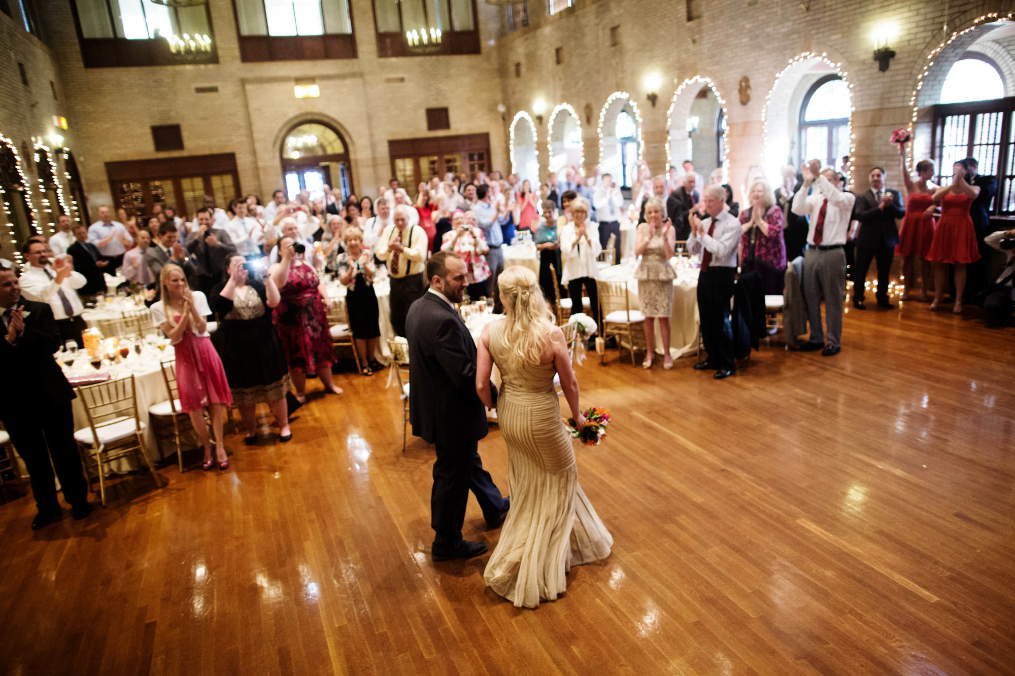 The bride and groom are introduced to their wedding reception at St Francis Hall.