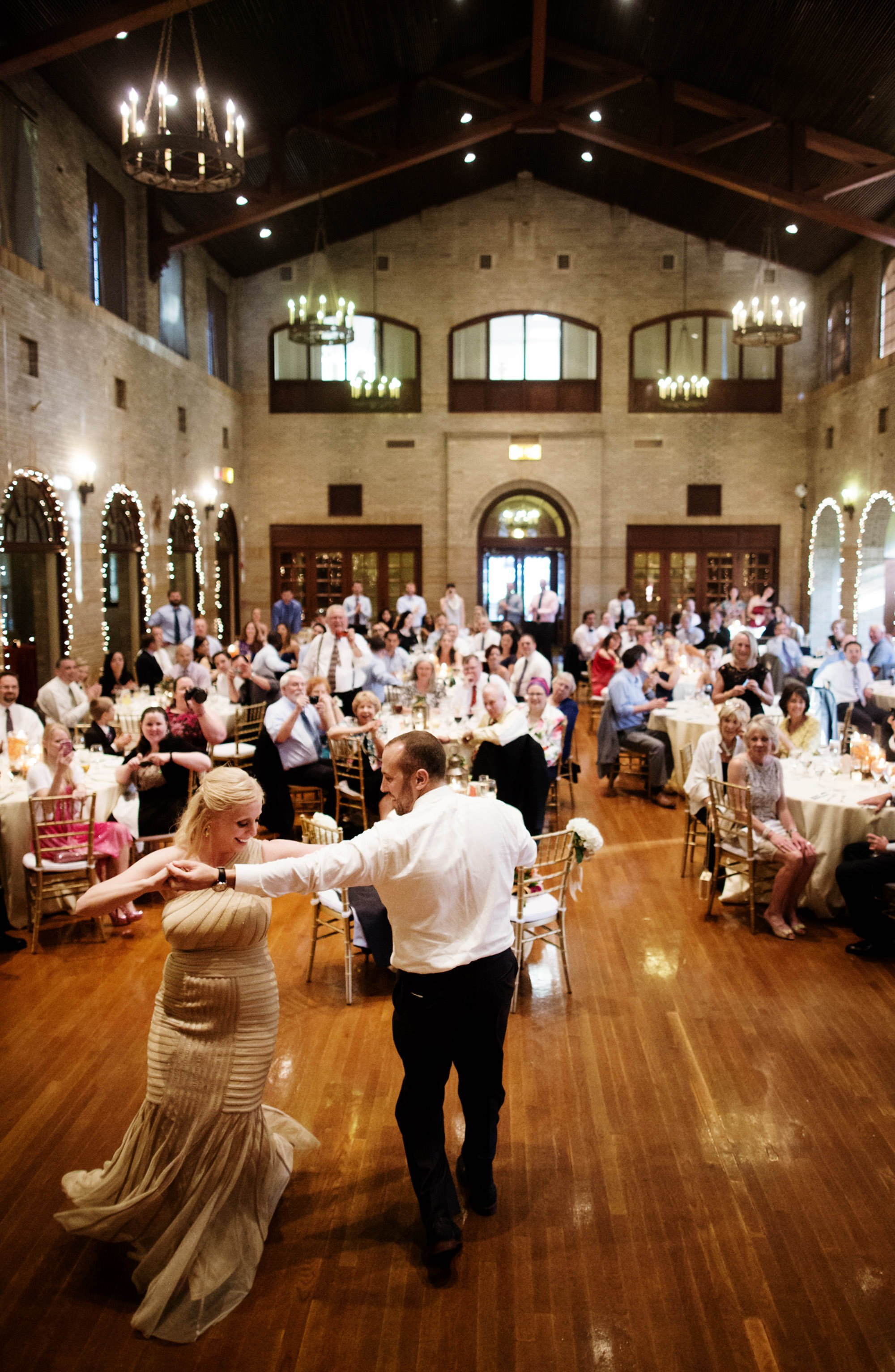 The bride and groom enjoy their first dance during their St Francis Hall wedding reception.
