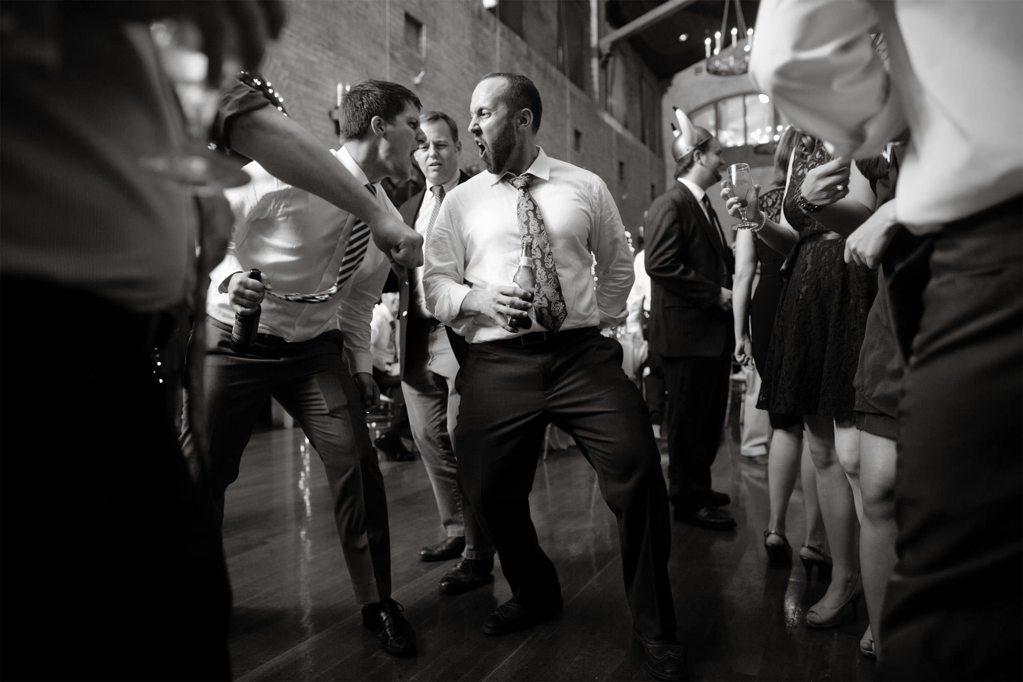 The groom dances with guests during his St Francis Hall wedding reception.