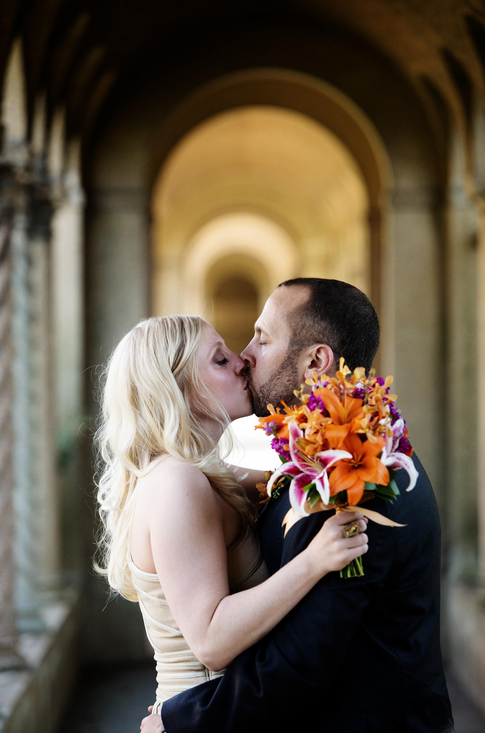 The couple kisses before their wedding at St Francis Hall.