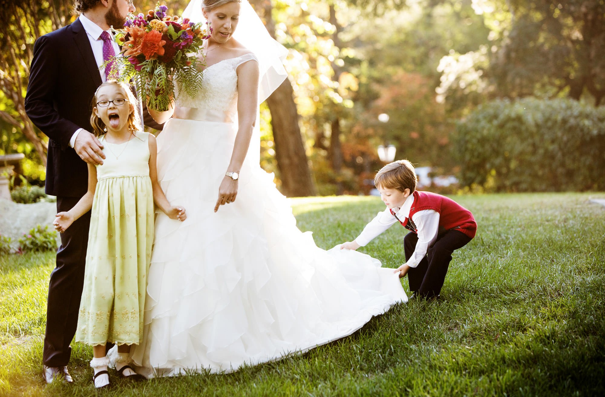 A silly portrait of the bride, groom, and children.