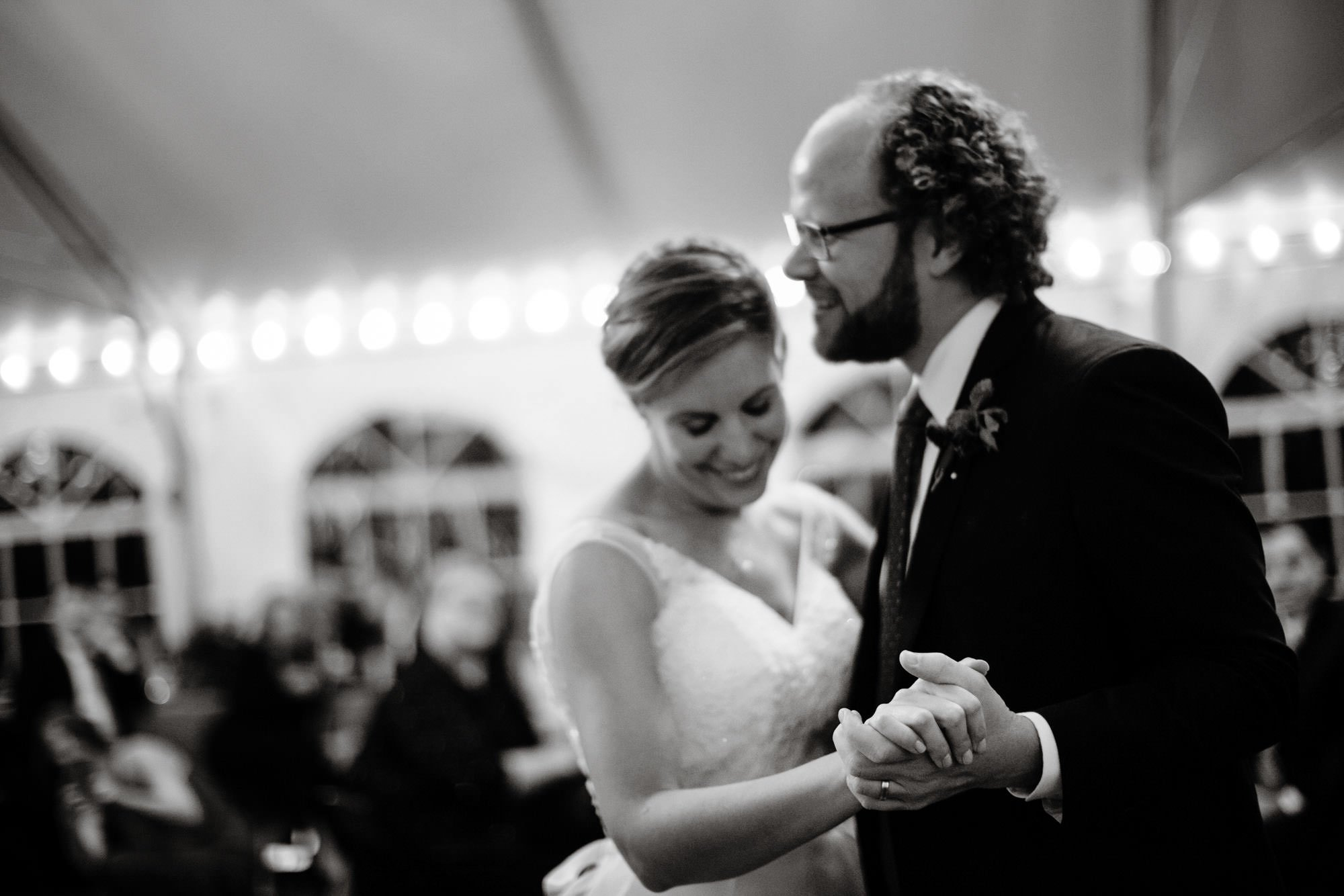 The couple share their first dance in the tented reception at Strong Mansion.