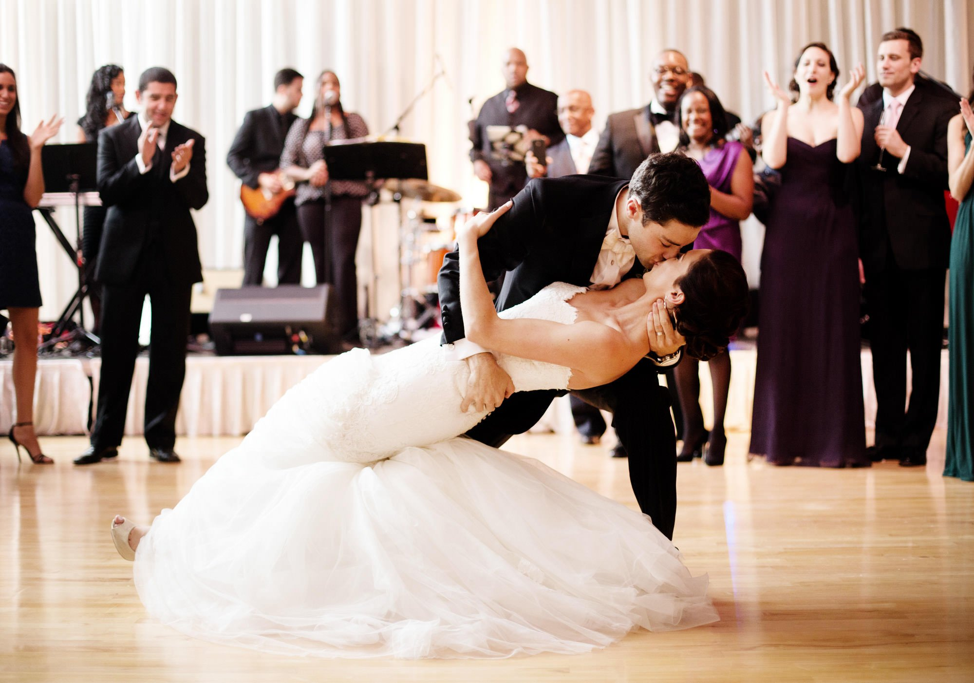 The groom dips his bride during the first dance of their Temple Rodef Shalom wedding.
