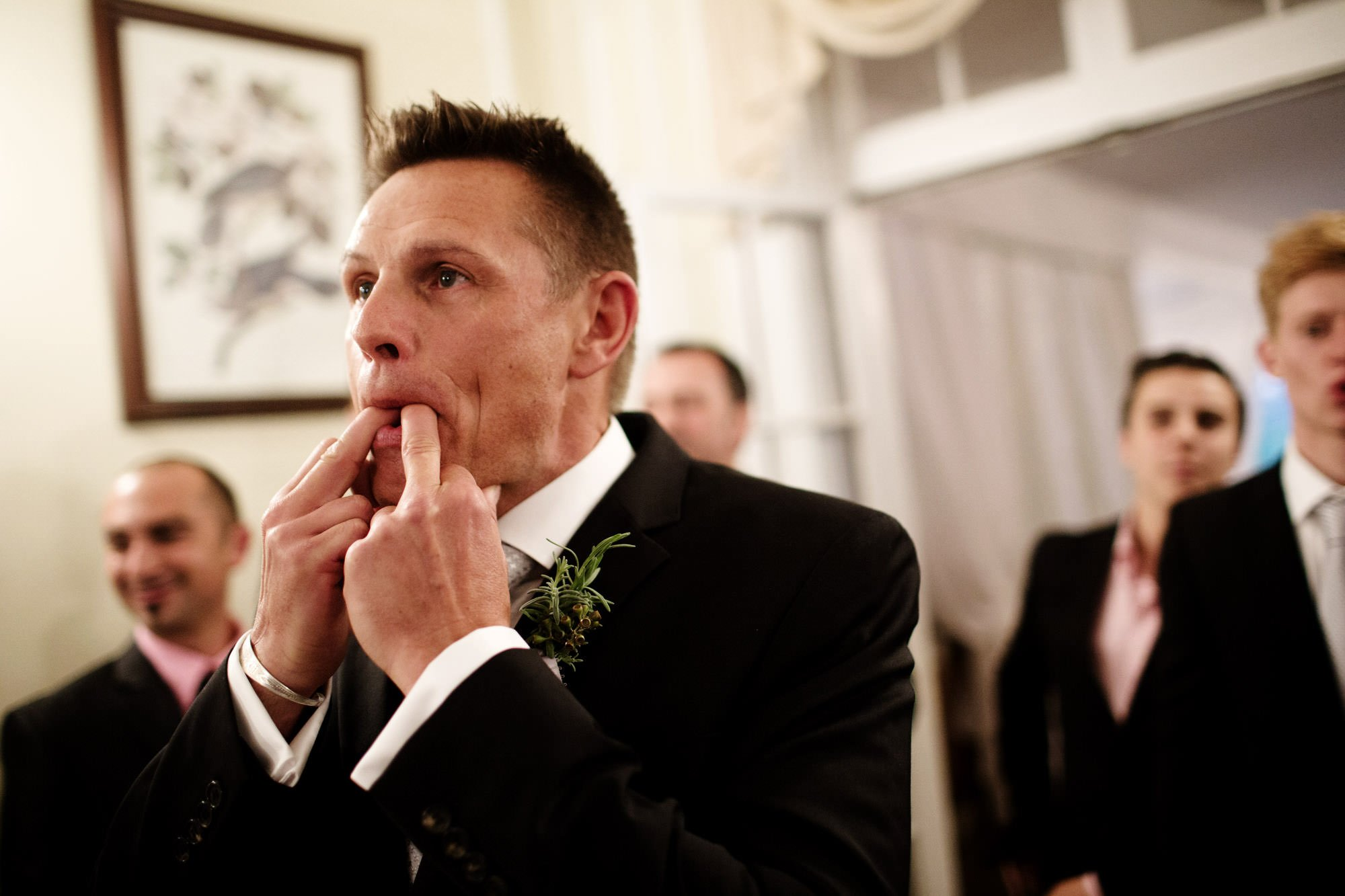The groom whistles as his bride walks down the stairs during his Woodend Sanctuary Wedding.